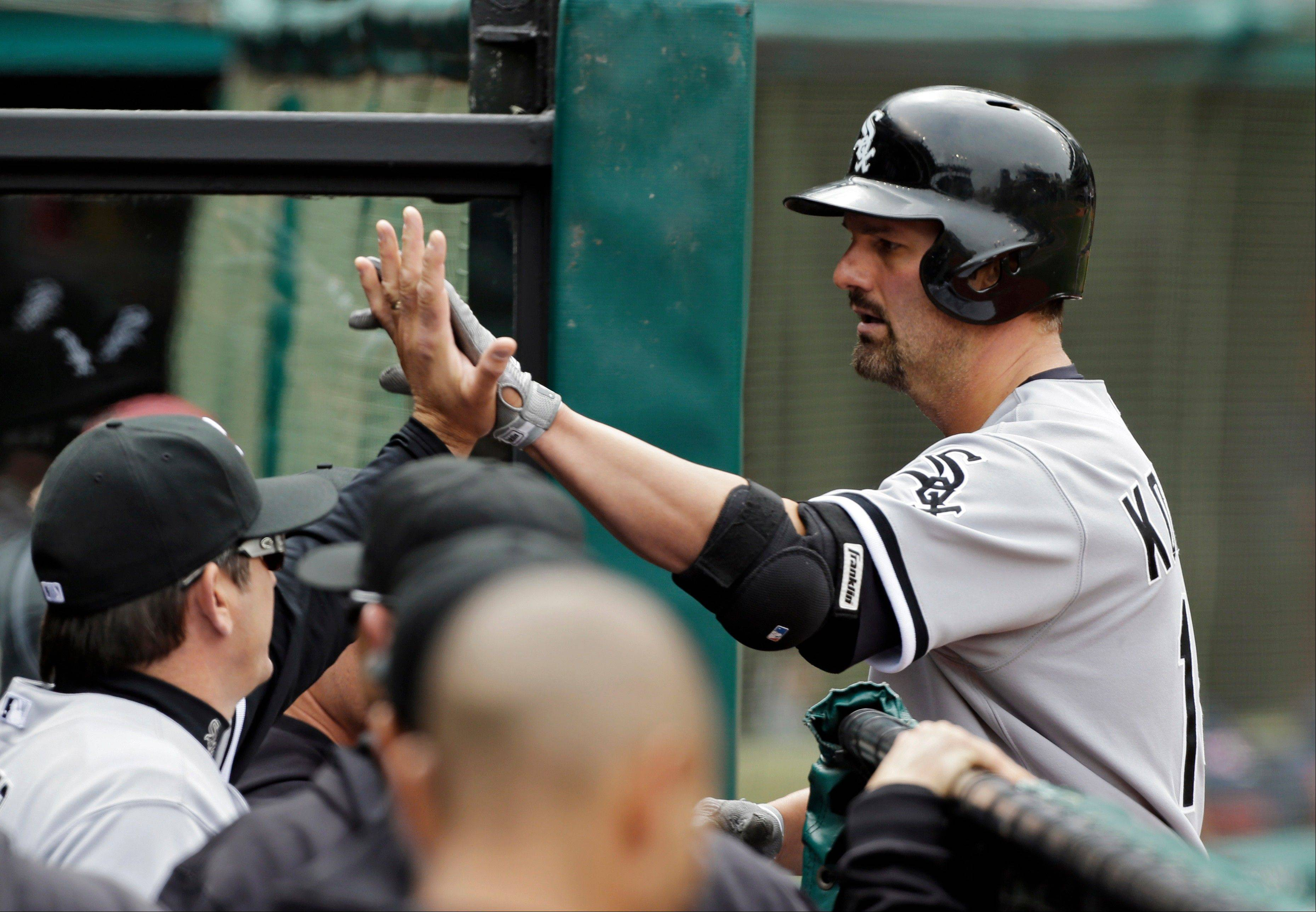 Chicago White Sox first baseman Paul Konerko is welcomed to the dugout after a two-run home run in the sixth inning of an MLB baseball game against the Cleveland Indians Sunday, April 14, 2013, in Cleveland. Konerko�s home run proved to be the game winner as the White Sox held on for a 3-1 win.
