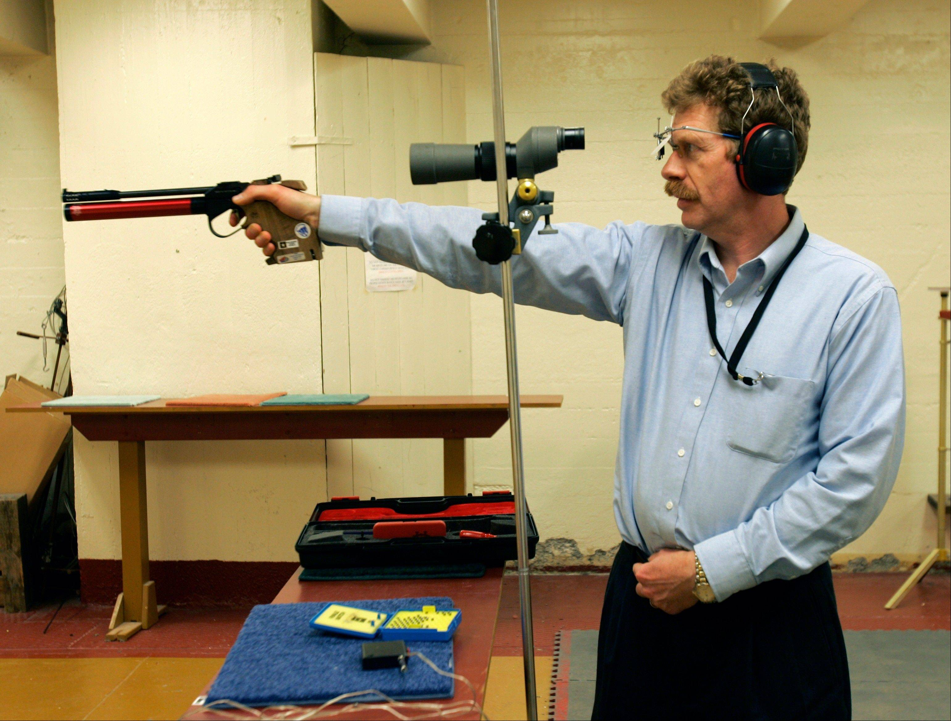 Bruce Martindale takes aim as he competes in a weekly air gun league in Troy, N.Y. Martindale, who normally uses a .22-caliber, has cut back on practice because ammunition is in short supply.