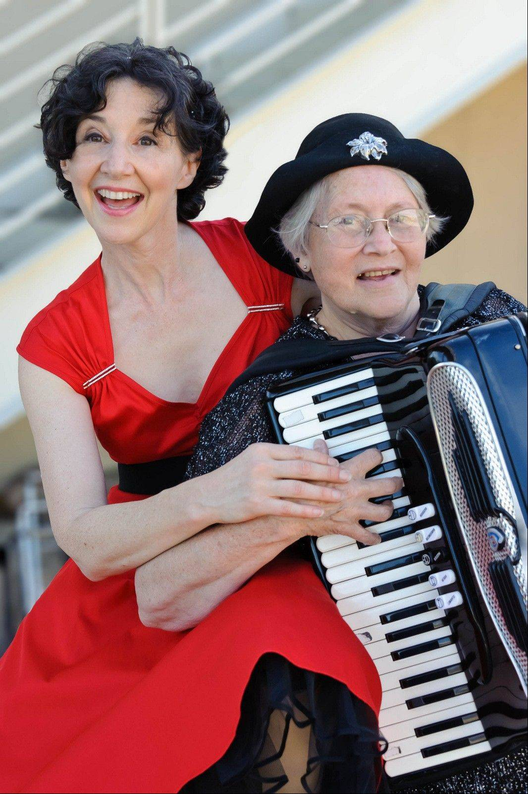 "Singer Claudia Hommel, left, and accordionist Pat Spaeth star in the ""April in Paris"" concert at the Wheaton Public Library."