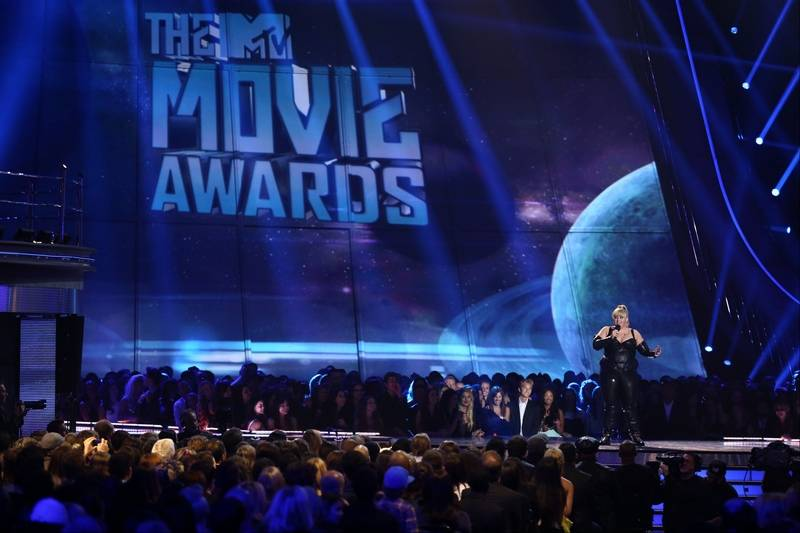 Host rebel wilson performs on stage at the mtv movie awards in sony