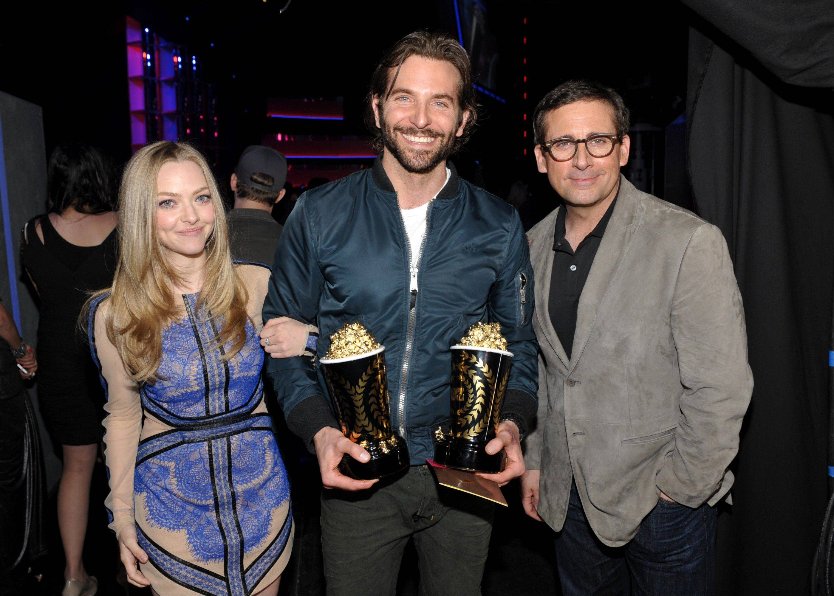 "Actor Bradley Cooper, center, winner of the best male performance and best kiss awards for ""Silver Linings Playbook"" poses backstage with actors Amanda Seyfried and Steve Carell at the MTV Movie Awards in Sony Pictures Studio Lot in Culver City, Calif., on Sunday April 14, 2013."