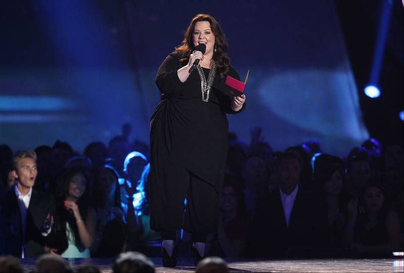 Actress melissa mccarthy presents the award for best male performance