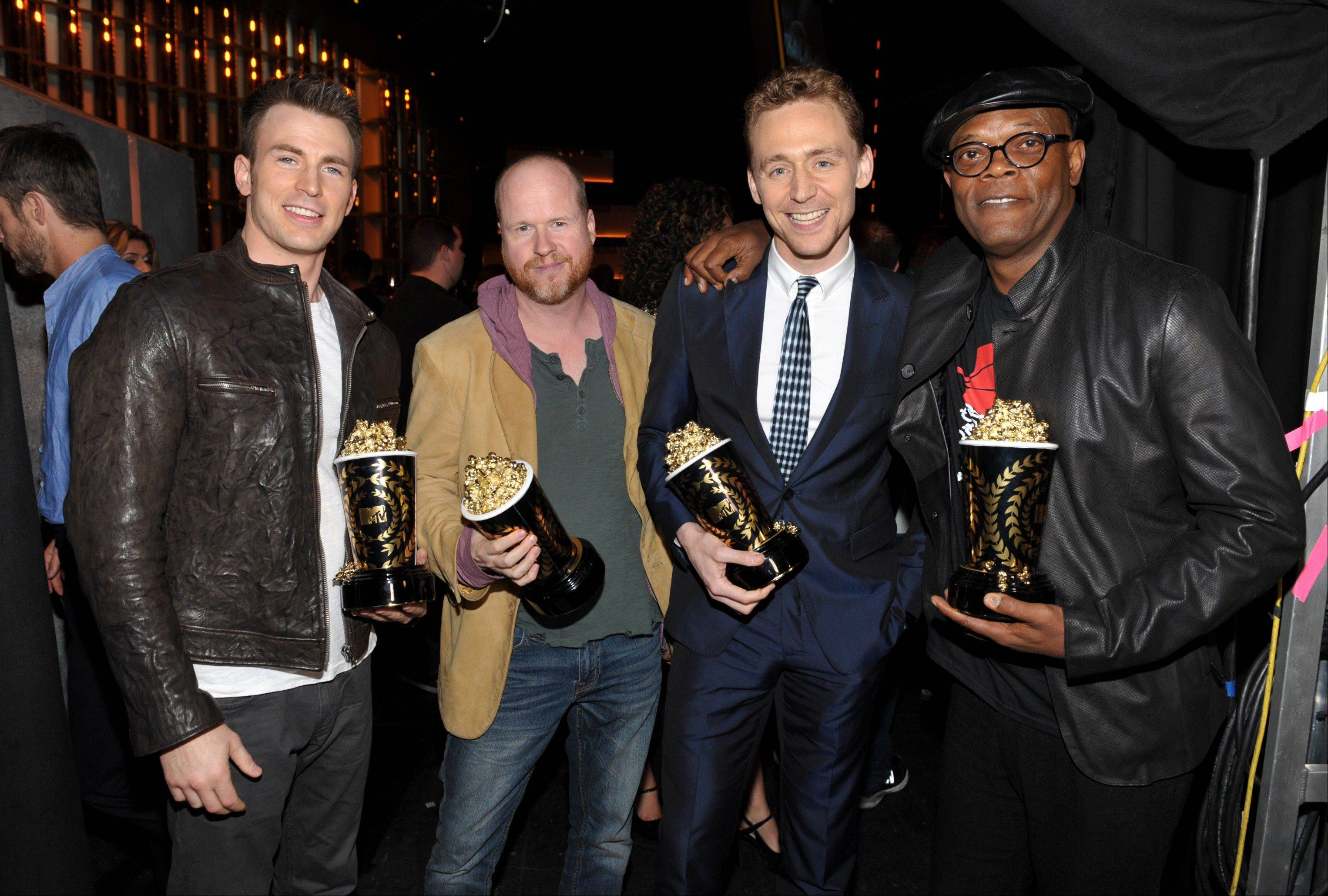 "Fom left, actor Chris Evans, director Joss Whedon, actor Tom Hiddleston winners of the award for best fight for ""The Avengers"" pose with actor Samuel L. Jackson, winner of the award for best WTF moment for ""Django Unchained"" backstage at the MTV Movie Awards in Sony Pictures Studio Lot in Culver City, Calif., on Sunday April 14, 2013."