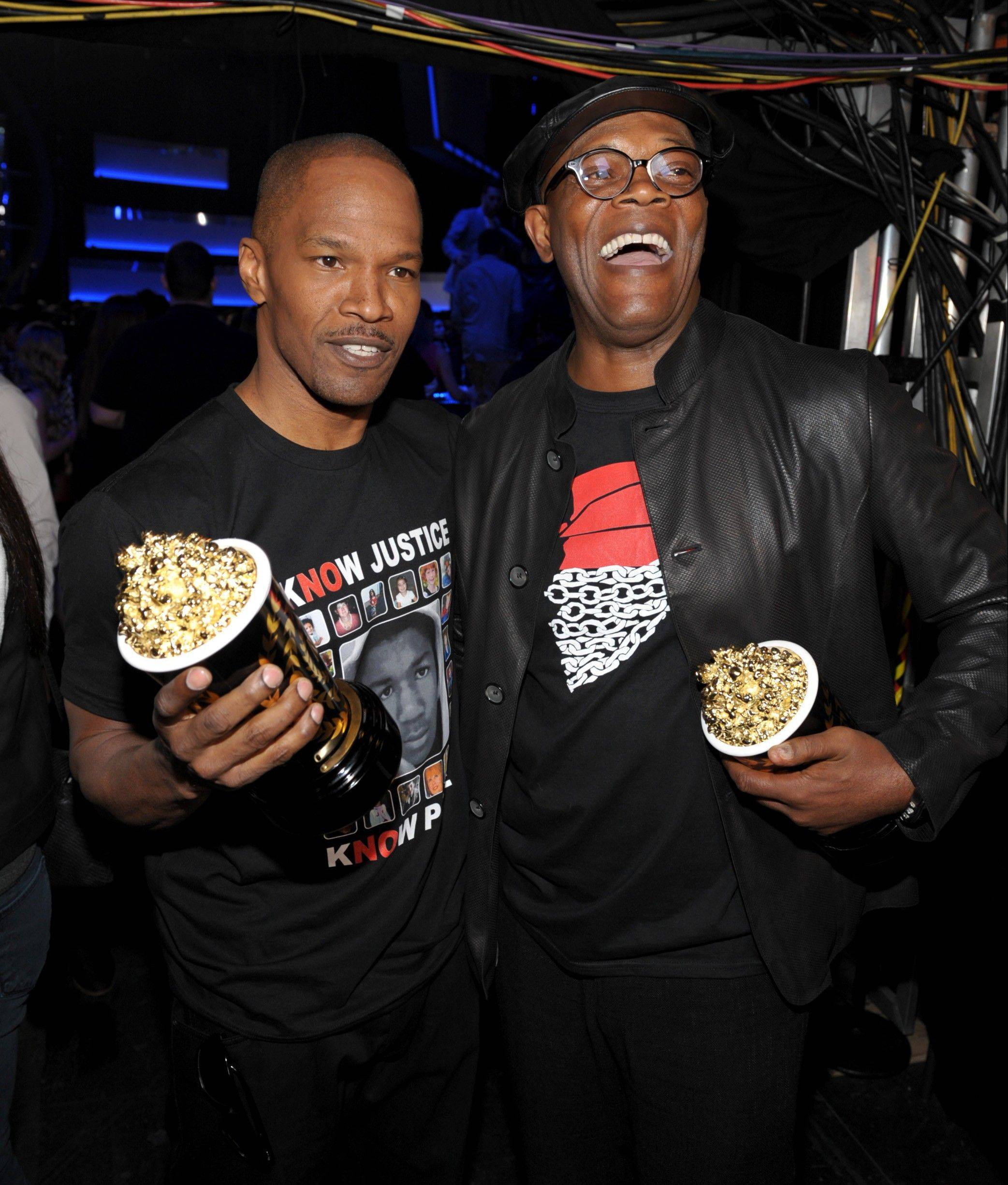 "Actors Jamie Foxx, left, and Samuel L. Jackson pose with their award for best WTF moment for ""Django Unchained."" Below right, Will Ferrell has a little fun with her comedic genius award. Below left, actors Melissa McCarthy and Bradley Cooper are all smiles after Cooper's win for best male performance."