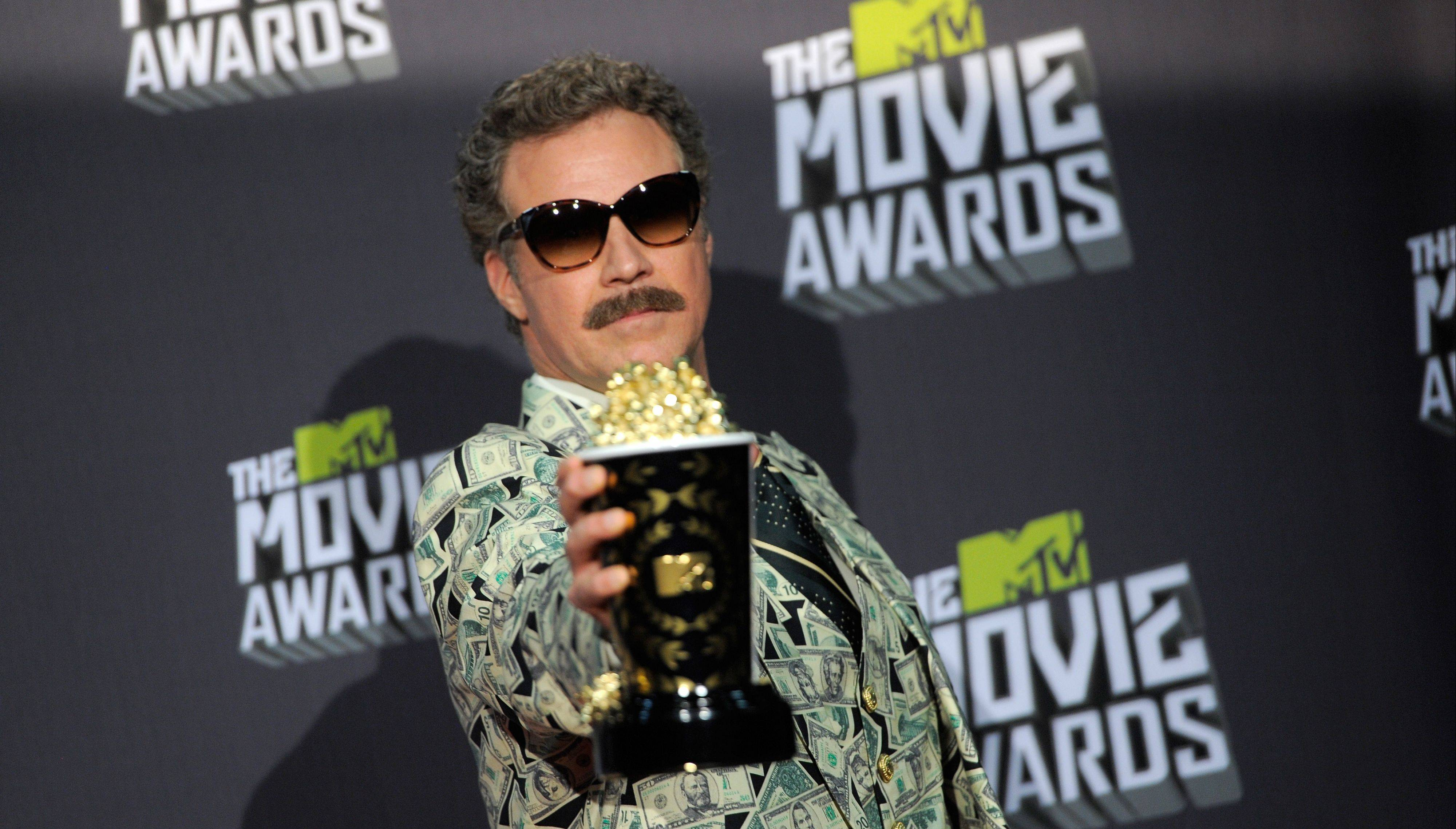 Will Ferrell poses with the comedic genius award backstage at the MTV Movie Awards in Sony Pictures Studio Lot in Culver City, Calif., on Sunday April 14, 2013.