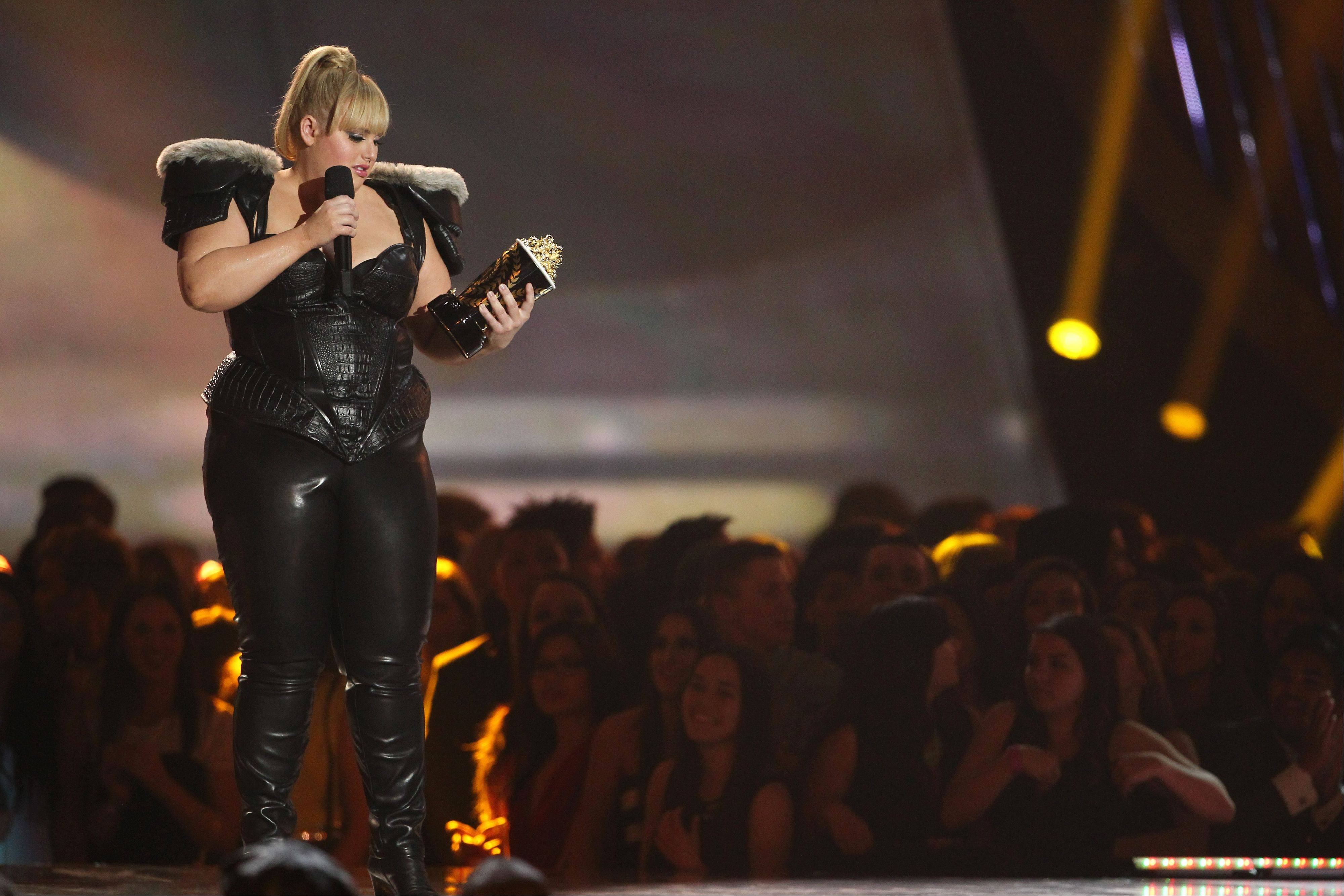 "Rebel Wilson accepts the award Sunday night for breakthrough performance for ""Pitch Perfect"" at the MTV Movie Awards in Sony Pictures Studio Lot in Culver City, Calif. Wilson also played host of the annual awards show."
