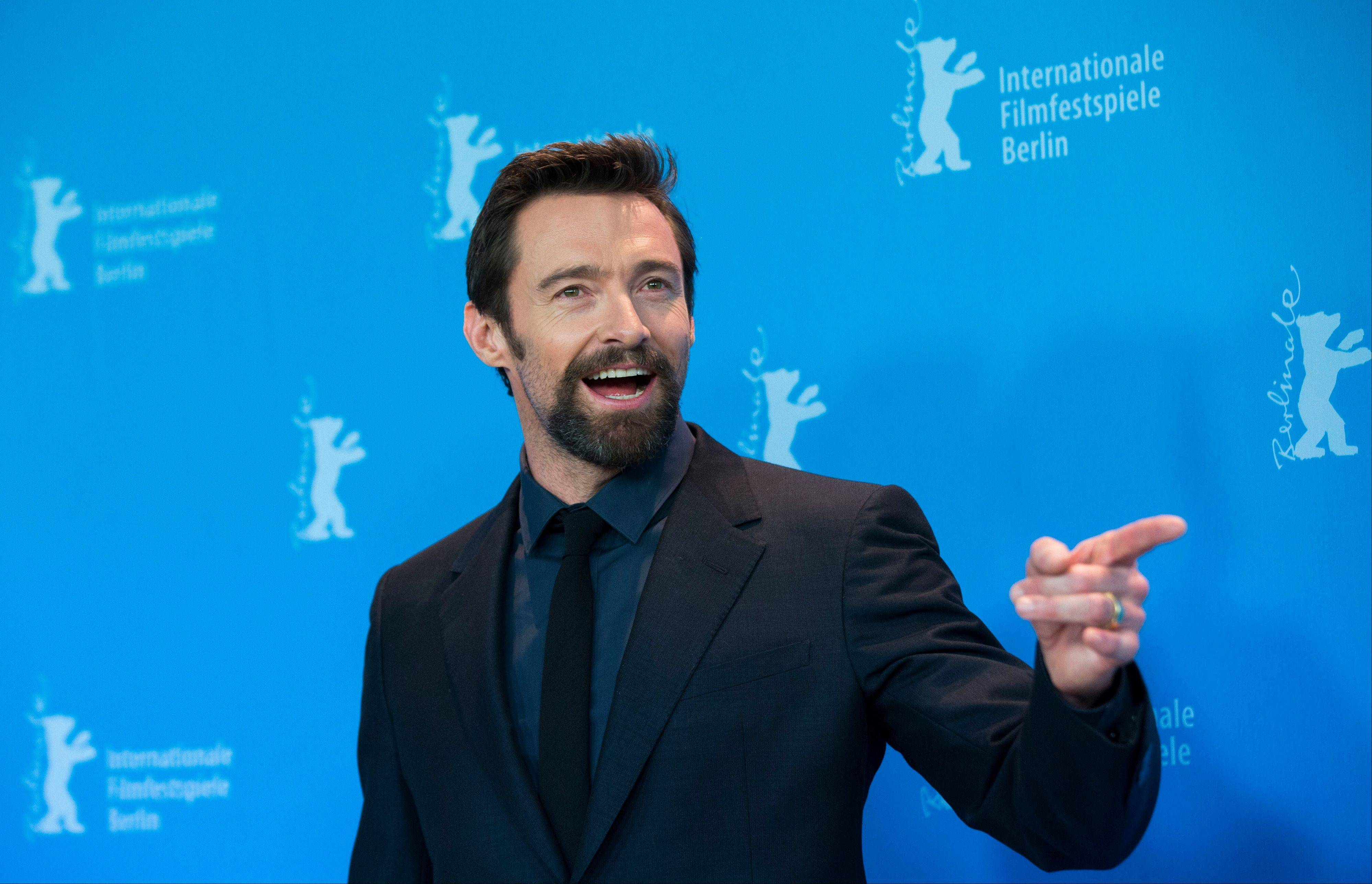 In this Saturday, Feb. 9, 2013 file photo, actor Hugh Jackman poses at the photo call of the film Les Miserables at the 63rd edition of the Berlinale, International Film Festival in Berlin. Police say 47-year-old Kathleen Thurston is charged with stalking Jackman after approaching him, crying and shouting, and throwing a razor at the Australian actor while he was working out at a gym in New York, on Saturday, April 13, 2013.