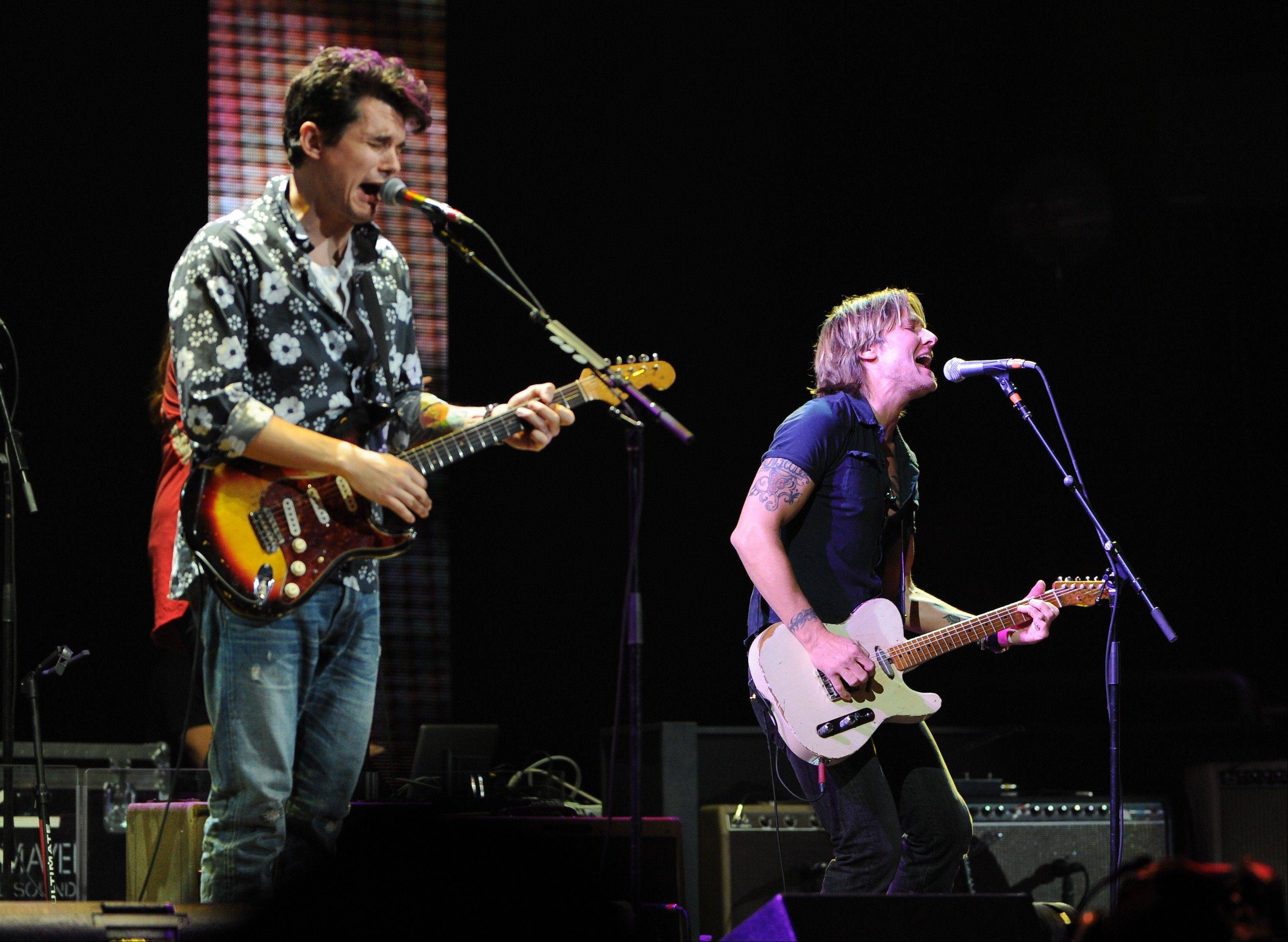 Musicians John Mayer, left, and Keith Urban perform together at Eric Clapton's Crossroads Guitar Festival 2013 at Madison Square Garden on Friday.