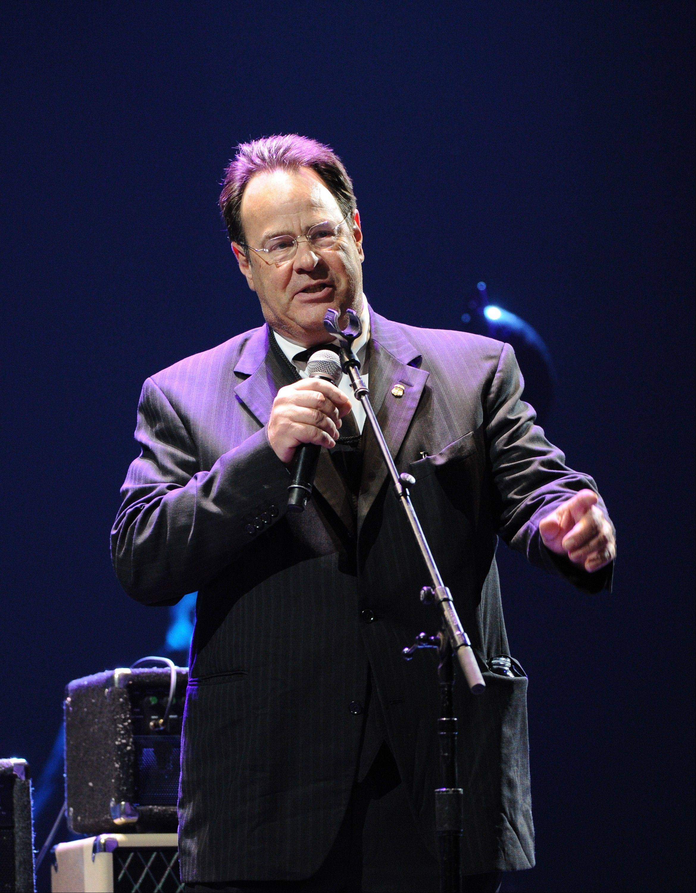 Actor and musician Dan Aykroyd serves as MC at Eric Clapton's Crossroads Guitar Festival 2013 at Madison Square Garden on Friday.