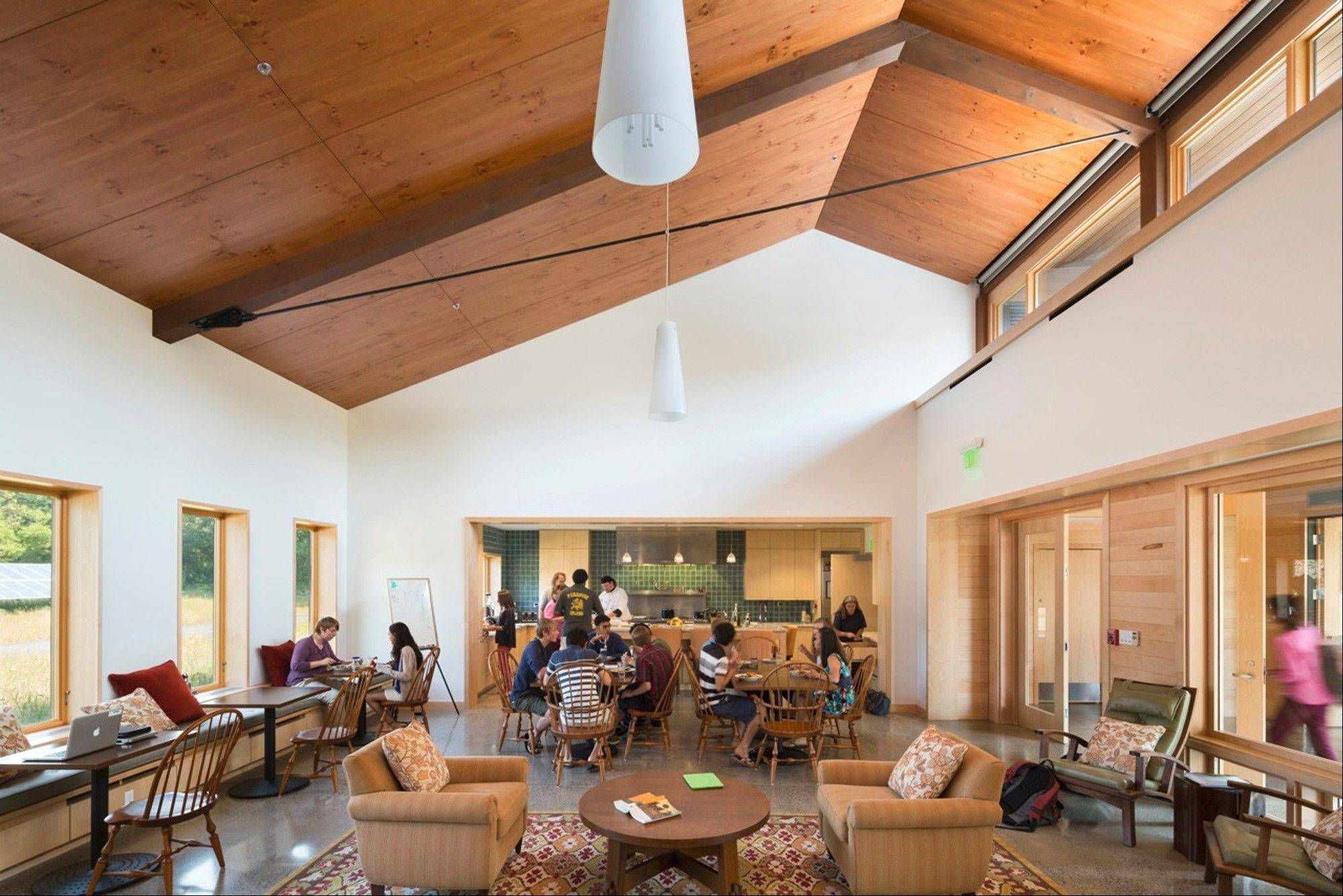 High windows offer ample daylight and summer cross ventilation in the common room of the Kohler Environmental Center.