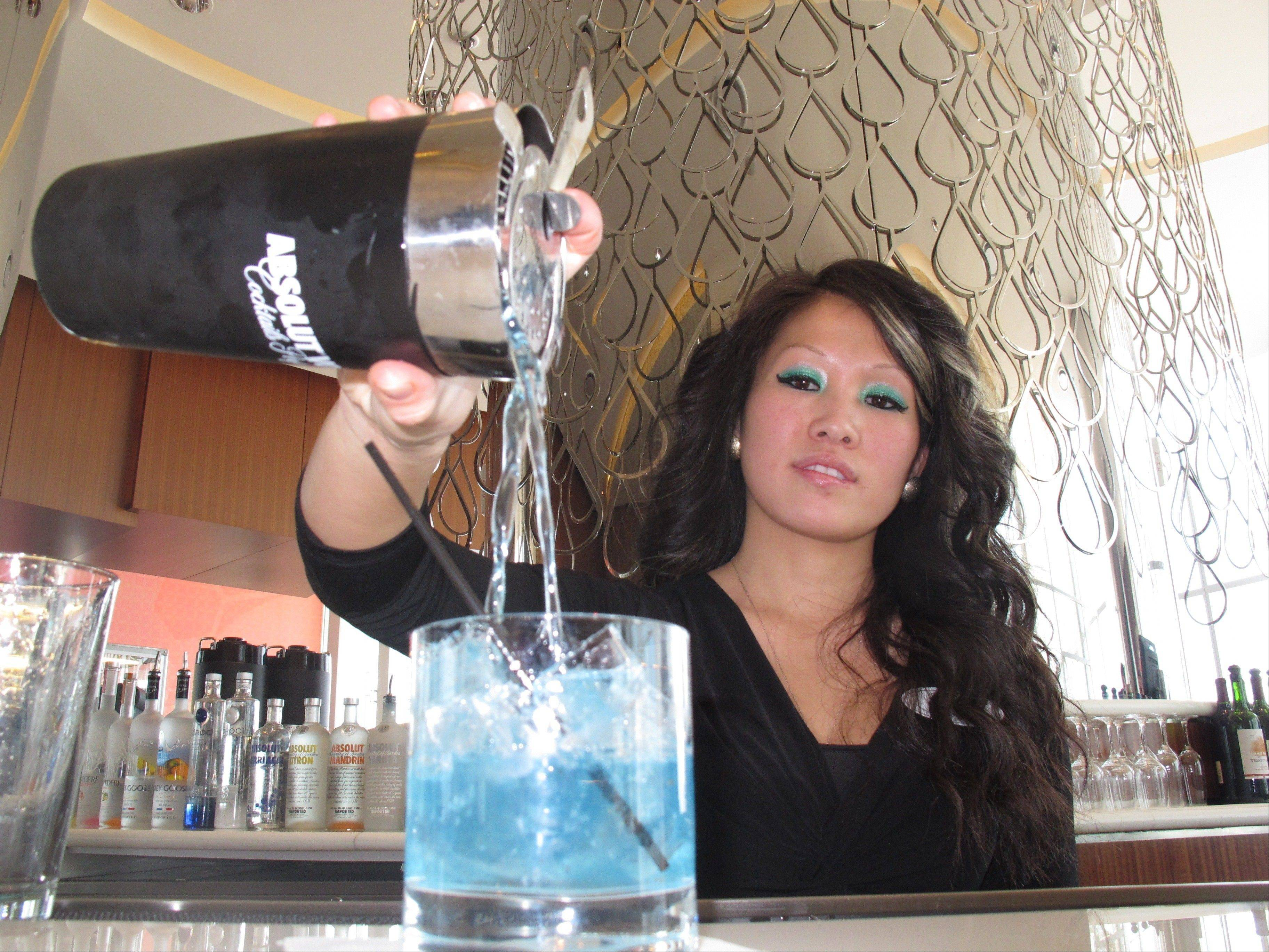 Mary Ma, a bartender at Revel in Atlantic City, N.J., pours a drink at one of the casino's bars.
