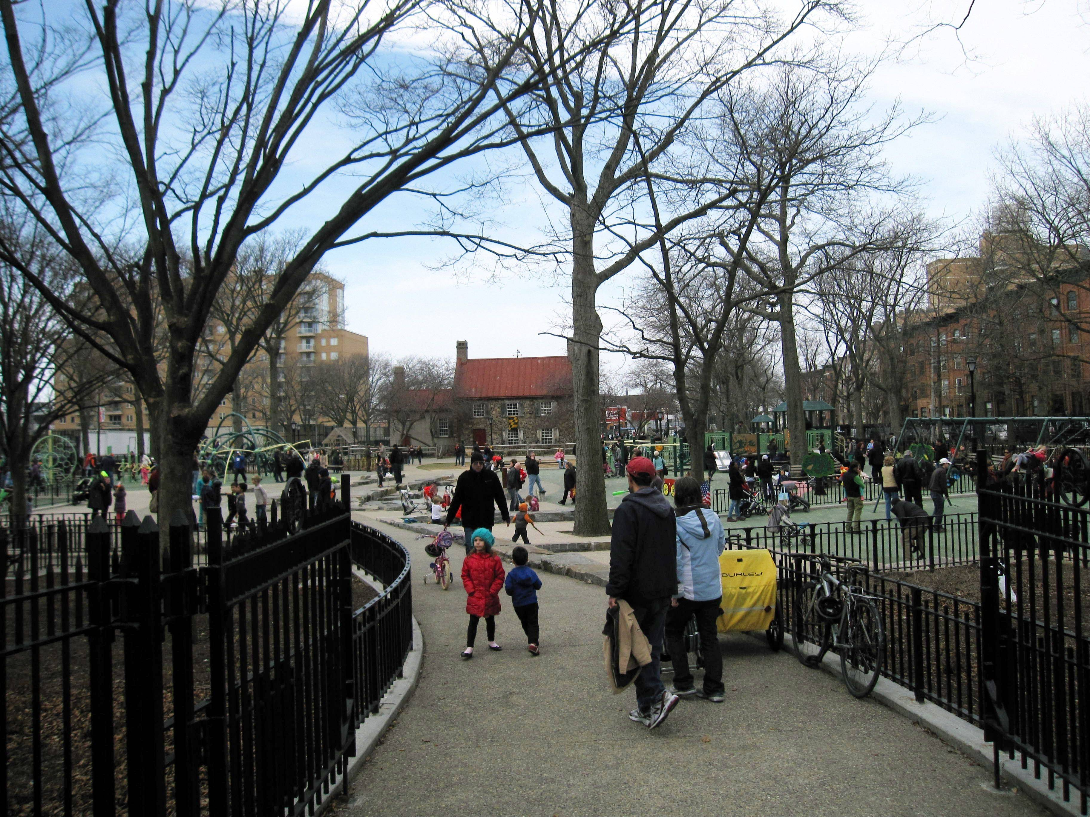 People in a playground at Washington Park in the Brooklyn borough of New York. A baseball park was located on the site beginning in the 1880s, and the team, later known as the Brooklyn Dodgers, used the Old Stone House, background center, as a clubhouse.