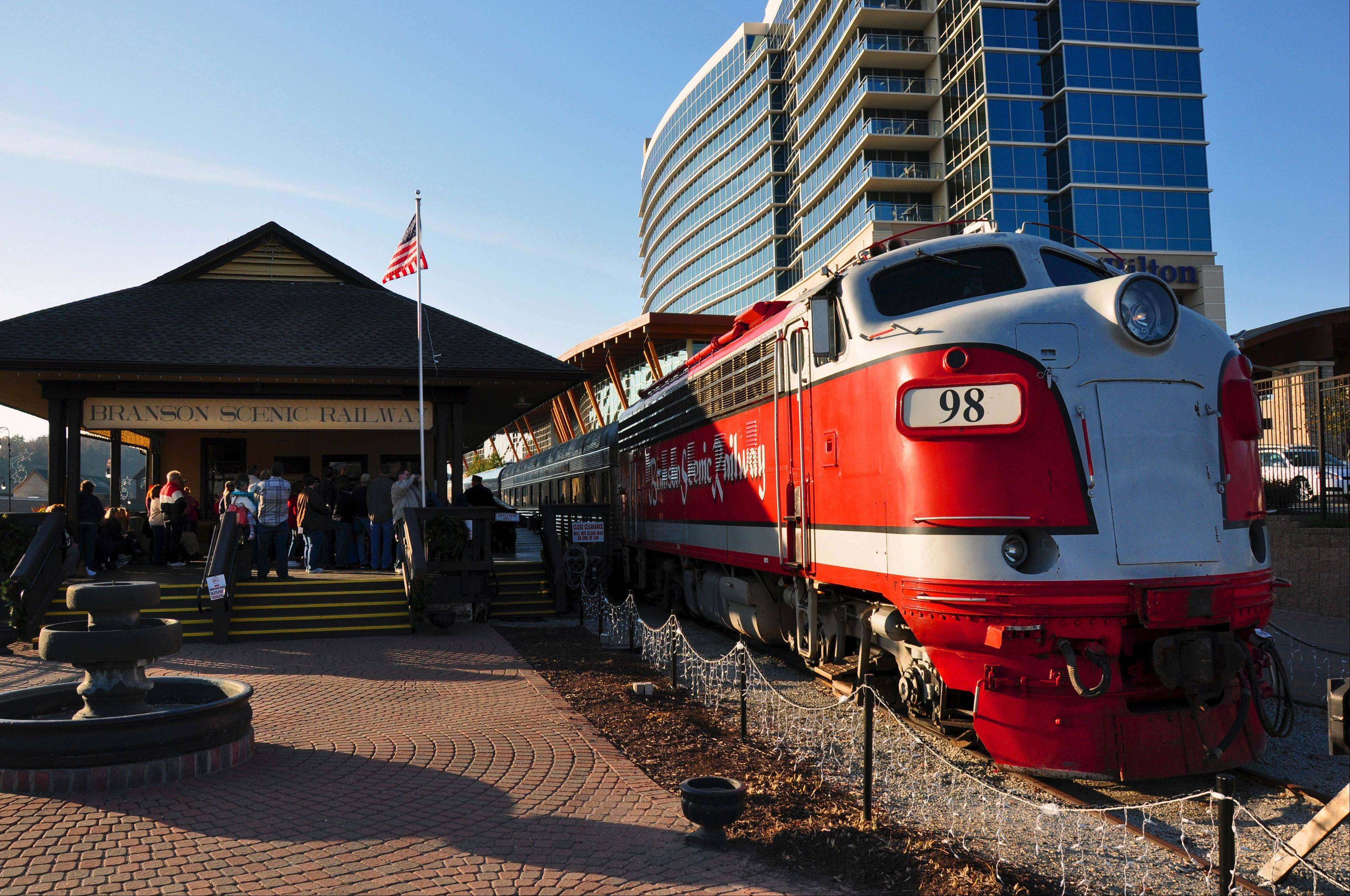 Excursions aboard vintage rail cars of the Branson Scenic Railway depart downtown Branson for the Ozark foothills.