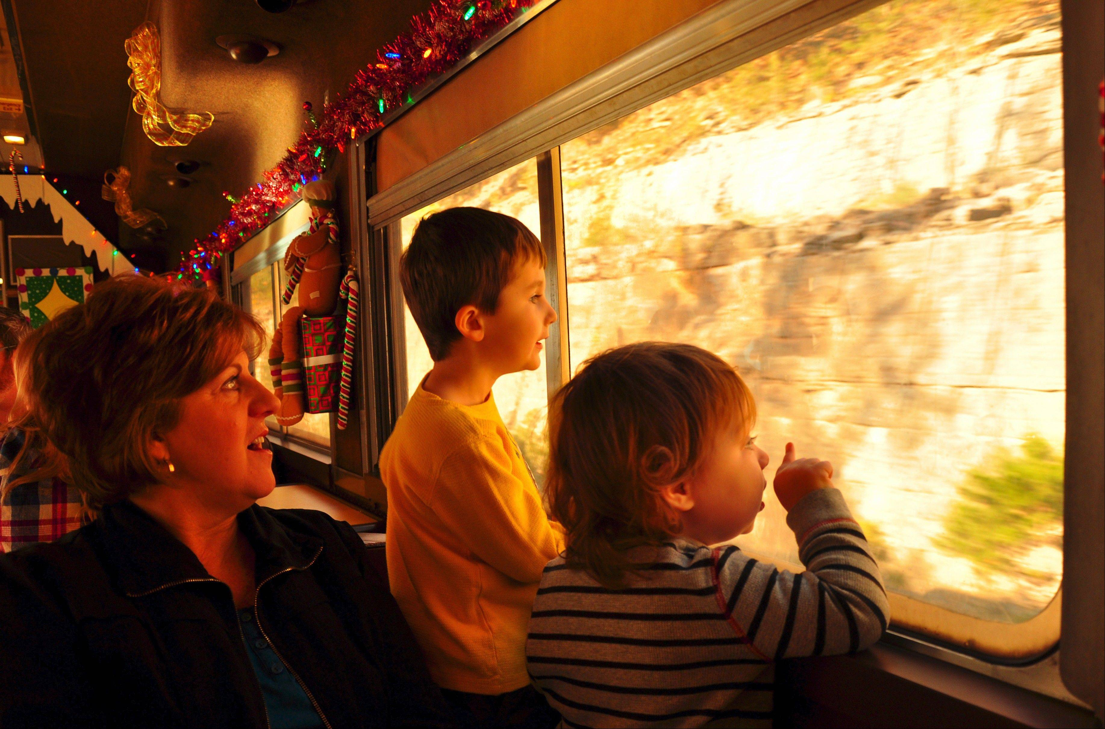Kathy Mathes of Jonesboro, Ark., watches over grandchildren Jack Keith and Glendon Scribner as they check out the scenery from a vintage coach car on the Branson Scenic Railway.
