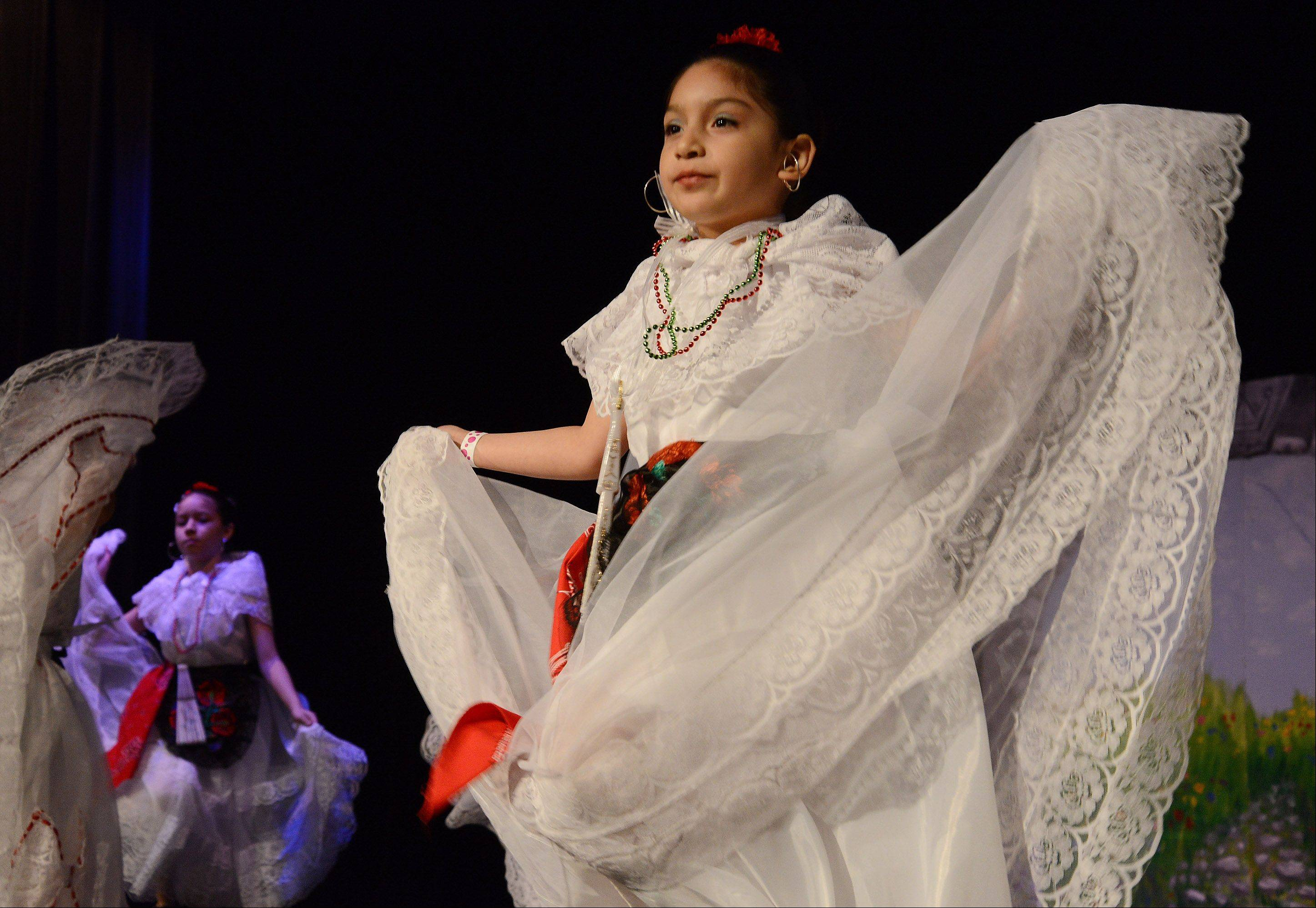 8-year-old Jackelyn Garcia dances in traditional Mexican garb during Grupo Folklorico Quetzal Mexican folk dance at the School District 54 and the Schaumburg Park District multicultural fair.