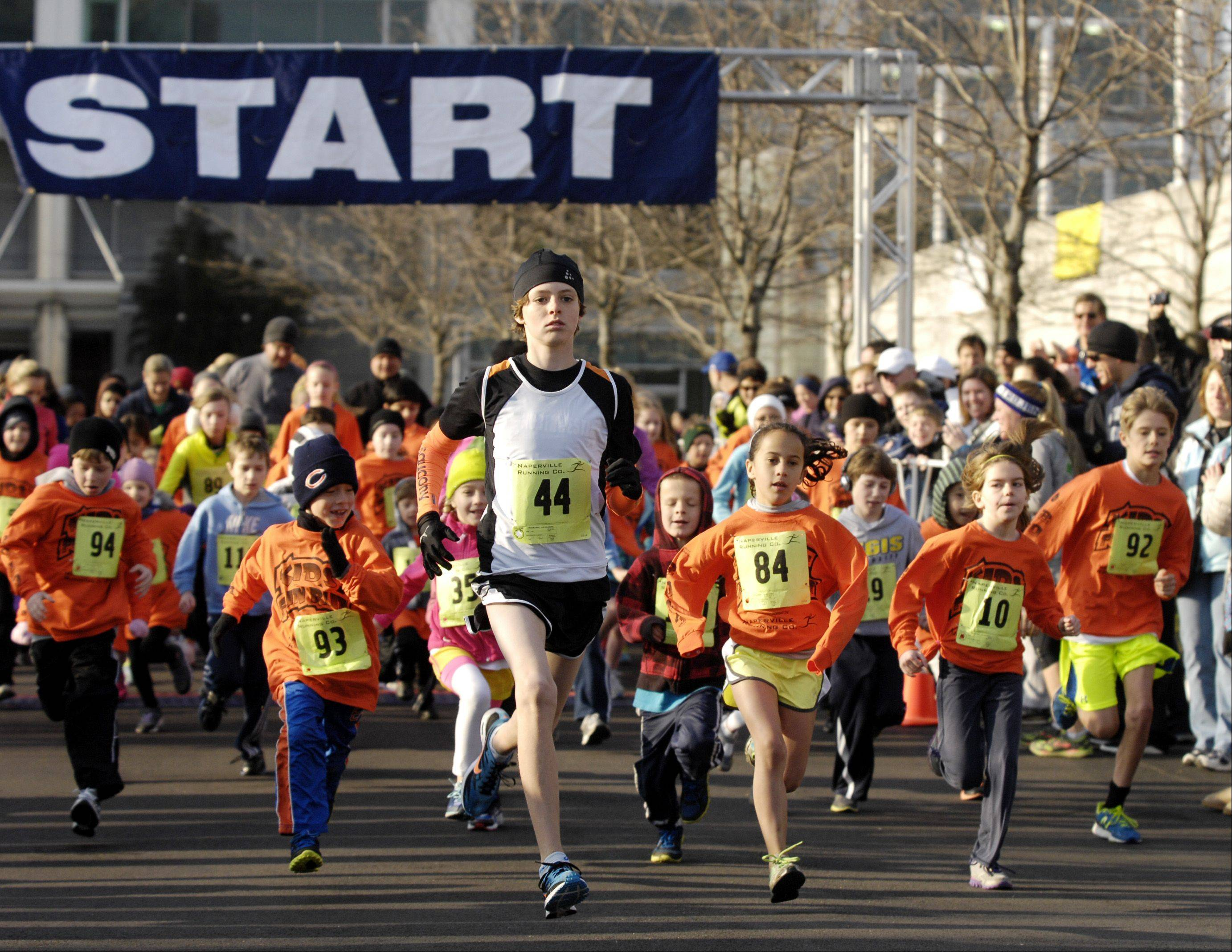 Jack James, 11, of Wheaton, takes the lead and keeps it to win the 1 mile Kids Fun Run during the 14th annual 360 Sprint Ahead Run in Naperville Sunday. The races benefit Naperville based 360 Youth Services.