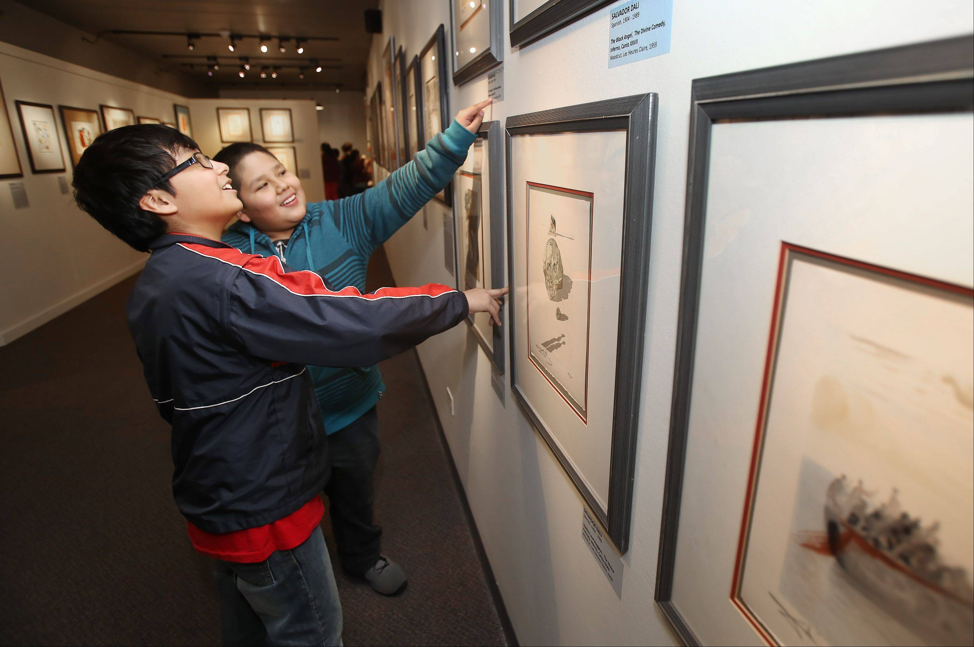 "Round Lake Middle School students Jared Mejia, left, and Ricardo Estino look at lithograghs by Salvadore Dali during the touring exhibition ""Modern Masters"" at the Discovery Museum in the Lakewood Forest Preserve near Wauconda. The works of Picasso, Dali, Miro and other greats can be seen at the show that opened April 6th."