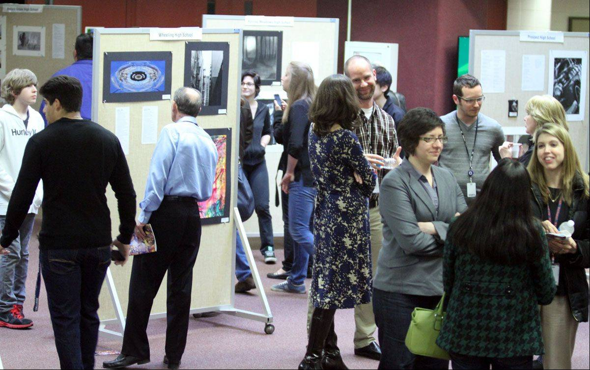 The annual Arts Unlimited reception at Forest View Educational Center in Arlington Heights draws a crowd Wednesday.