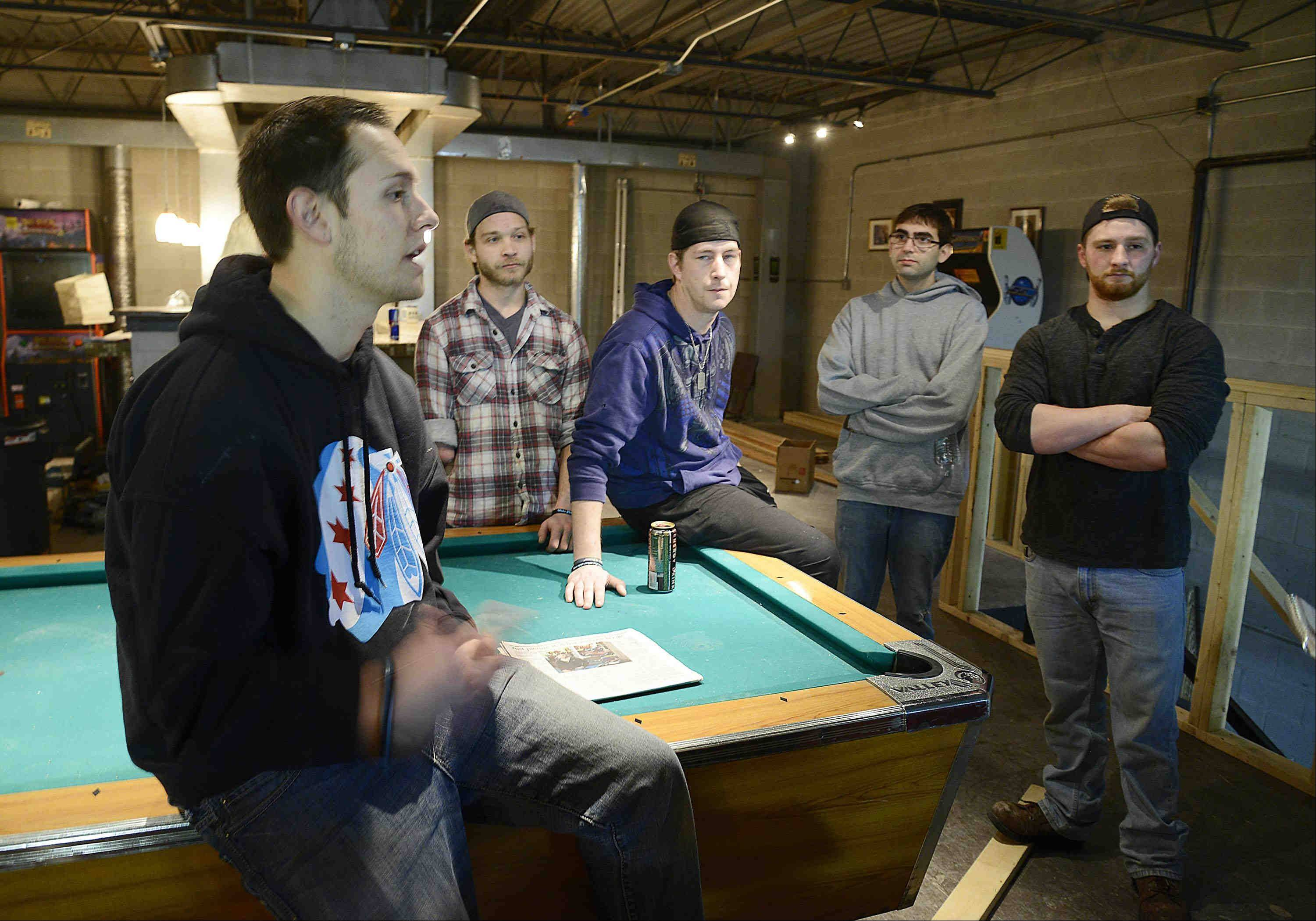 Chris Reed of Algonquin, from left, Aaron Cutler of Crystal Lake, Steve Staley of Lake in the Hills, Joe Bongiovanni of Algonquin and Mike Ledvora of Crystal Lake are opening a sober bar this month in Crystal Lake called The Other Side.