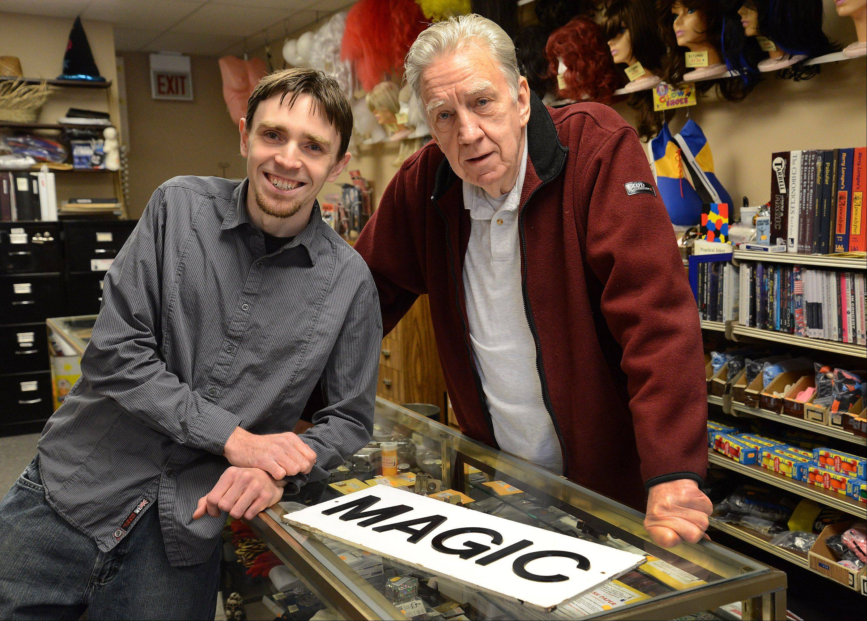 Father and son, Phil, right, and Brian Johnson have fun while working at PJ's Trick Shop in Arlington Heights.