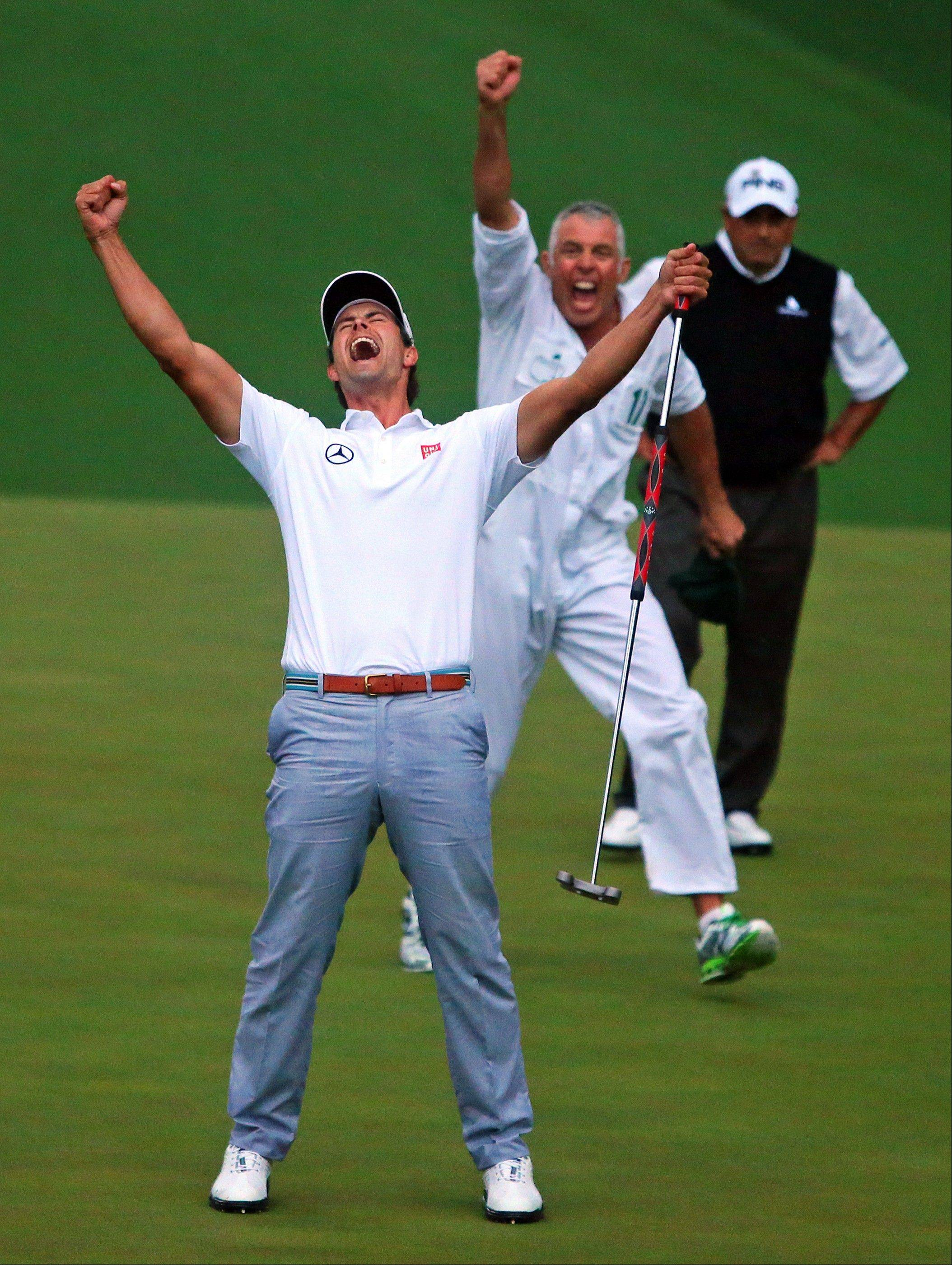 Adam Scott, of Australia, celebrates after making a birdie putt on the second playoff hole to win the Masters golf tournament Sunday, April 14, 2013, in Augusta, Ga.