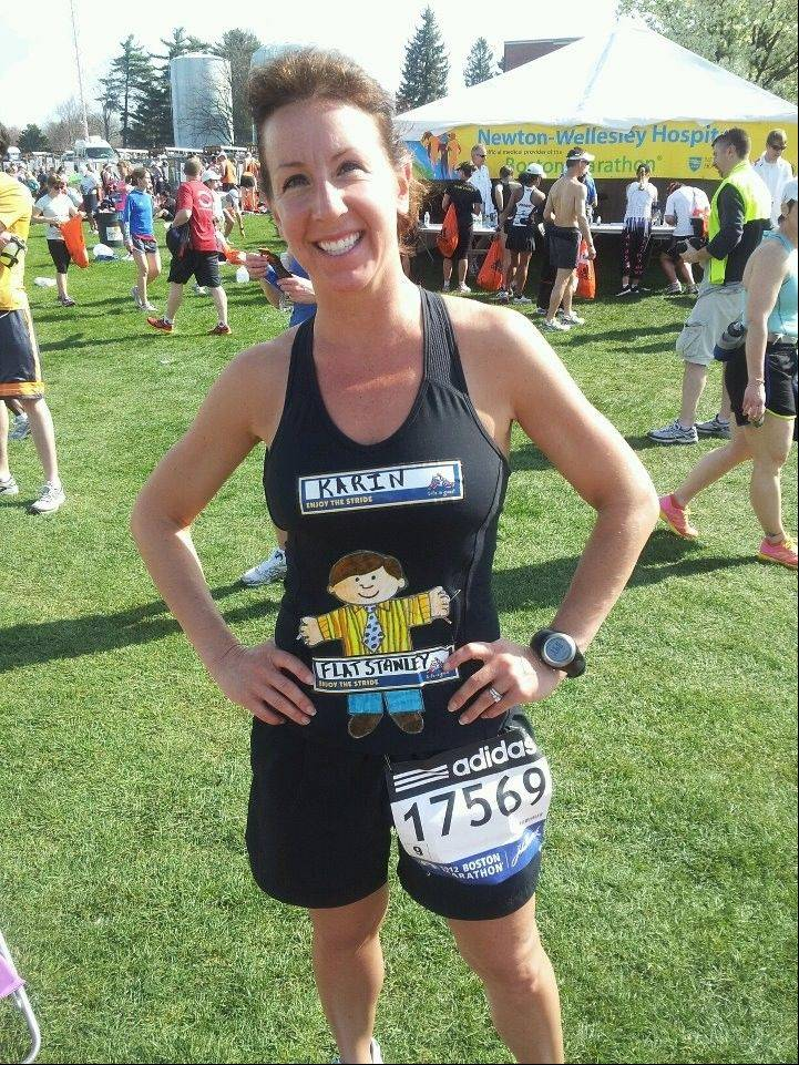 Karin Sheehy of Elgin poses before last year�s Boston Marathon.