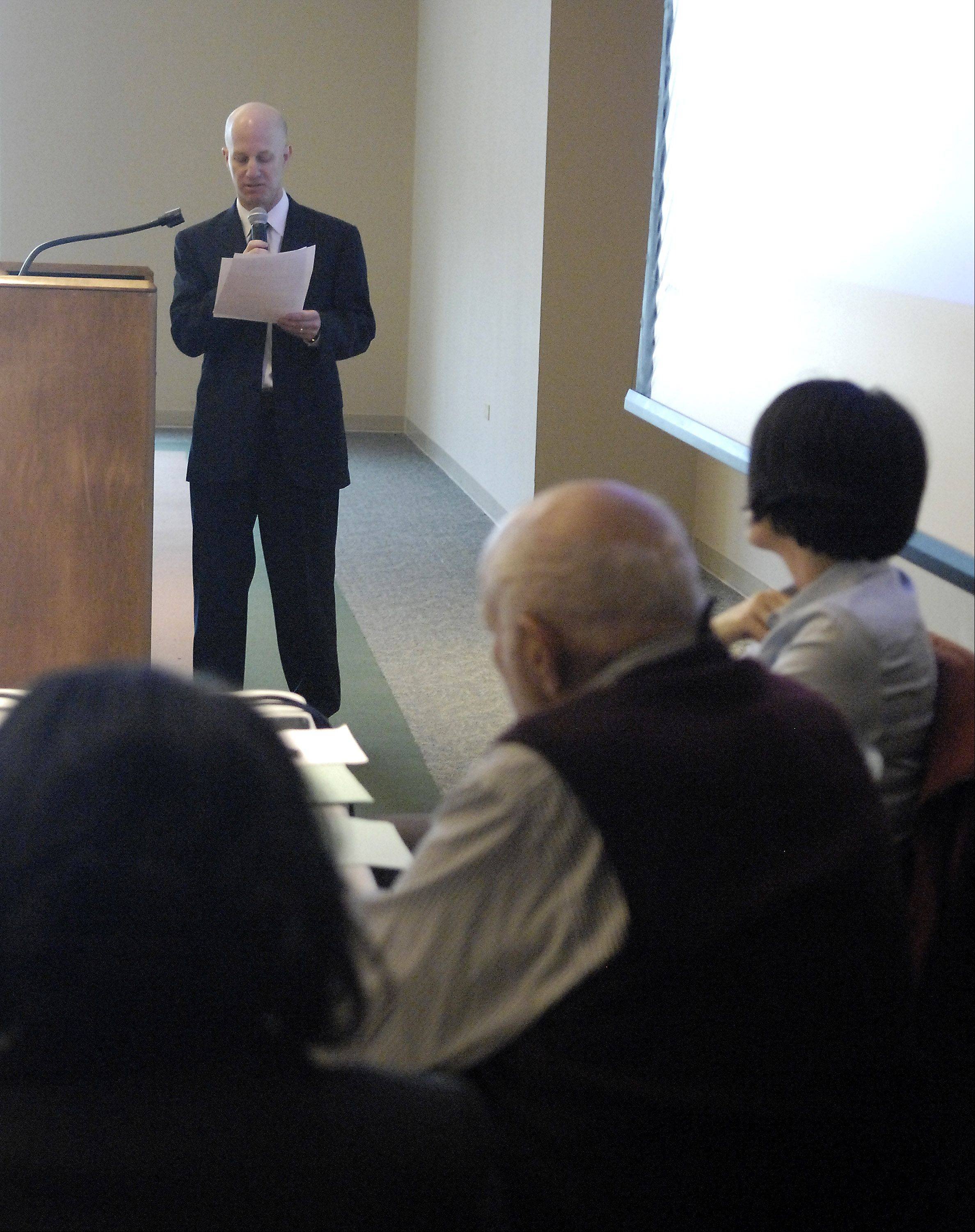 Scott Powder, senior vice president of strategic planning and growth at Advocate Health Care, addresses members of the Illinois Health Facilities and Services Review Board during a hearing Monday at the Centre of Elgin for the proposed Sherman Hospital-Advocate merger.