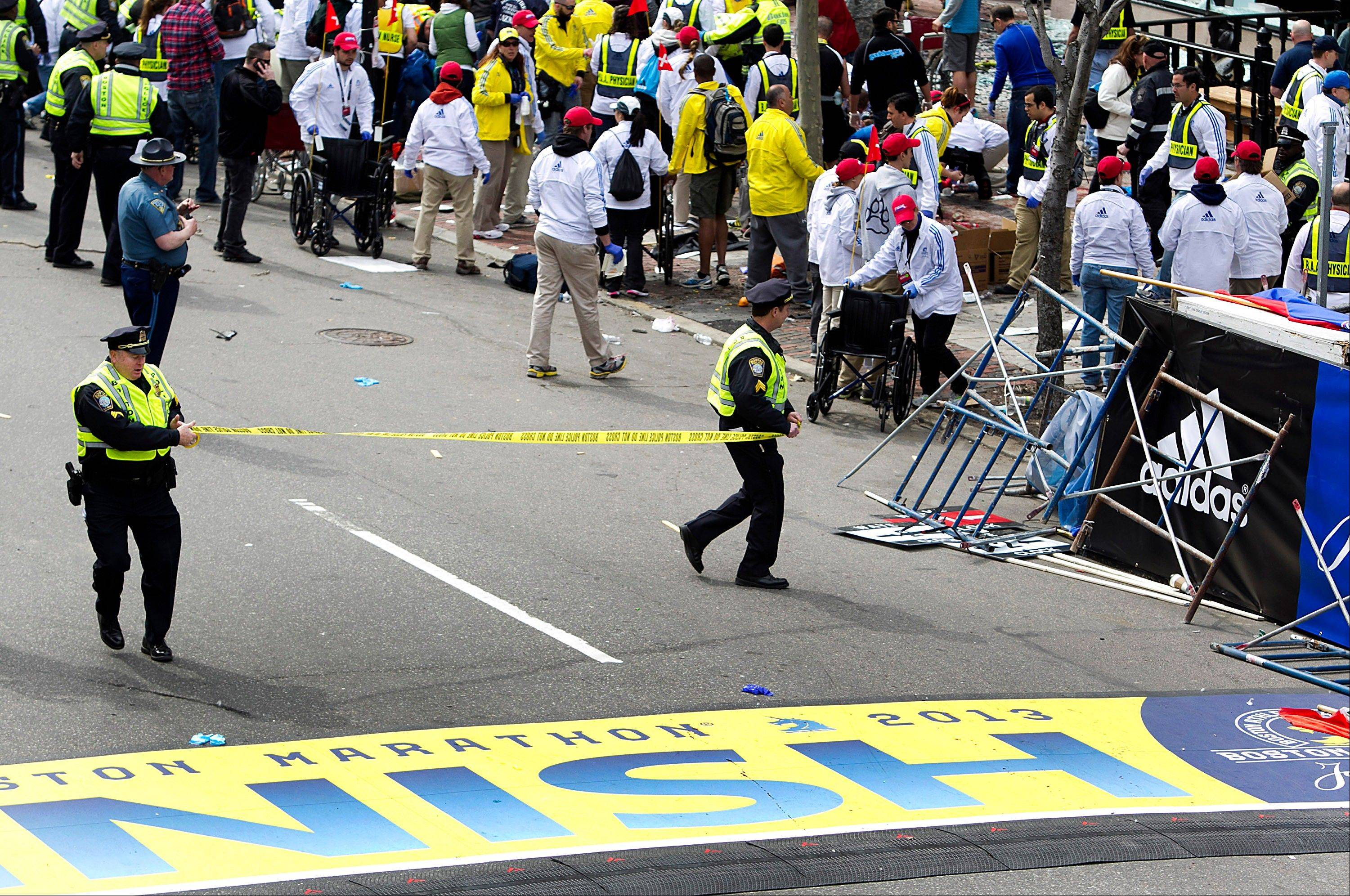 Police cordon off the finish line area where two explosions occurred along the final stretch of the Boston Marathon on Boylston Street Monday afternoon.
