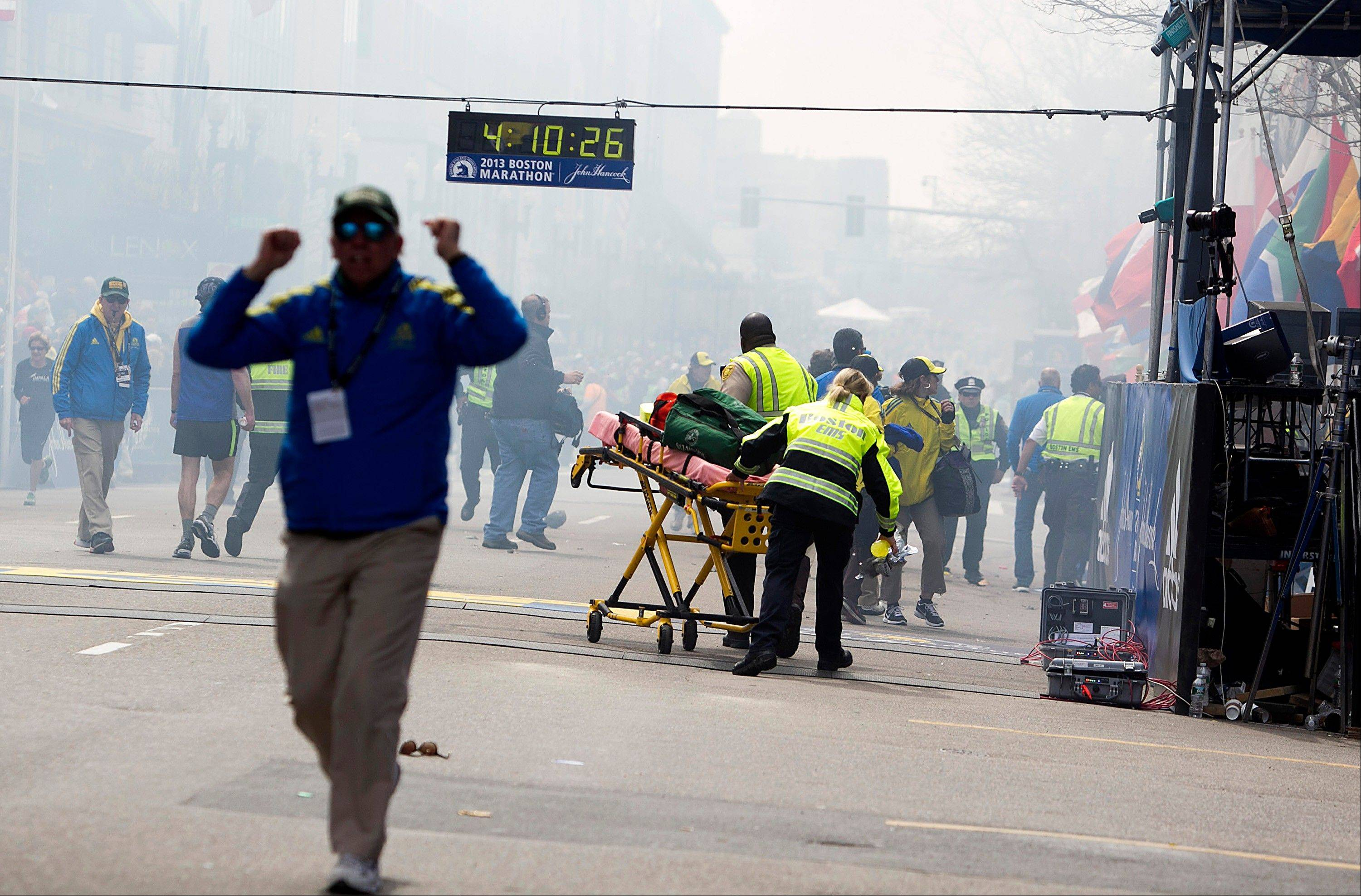First responders rush to where two explosions rocked the finish line area Monday at the Boston Marathon near Copley Square.