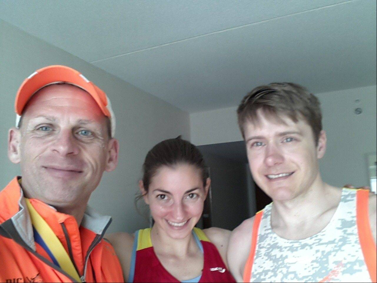 Ray Gobis, left, of Oak Forest, poses with friends Sherri and Steve Breese of Palatine before running the Boston Marathon Monday. They were not hurt and said they initially thought the explosion was fireworks.