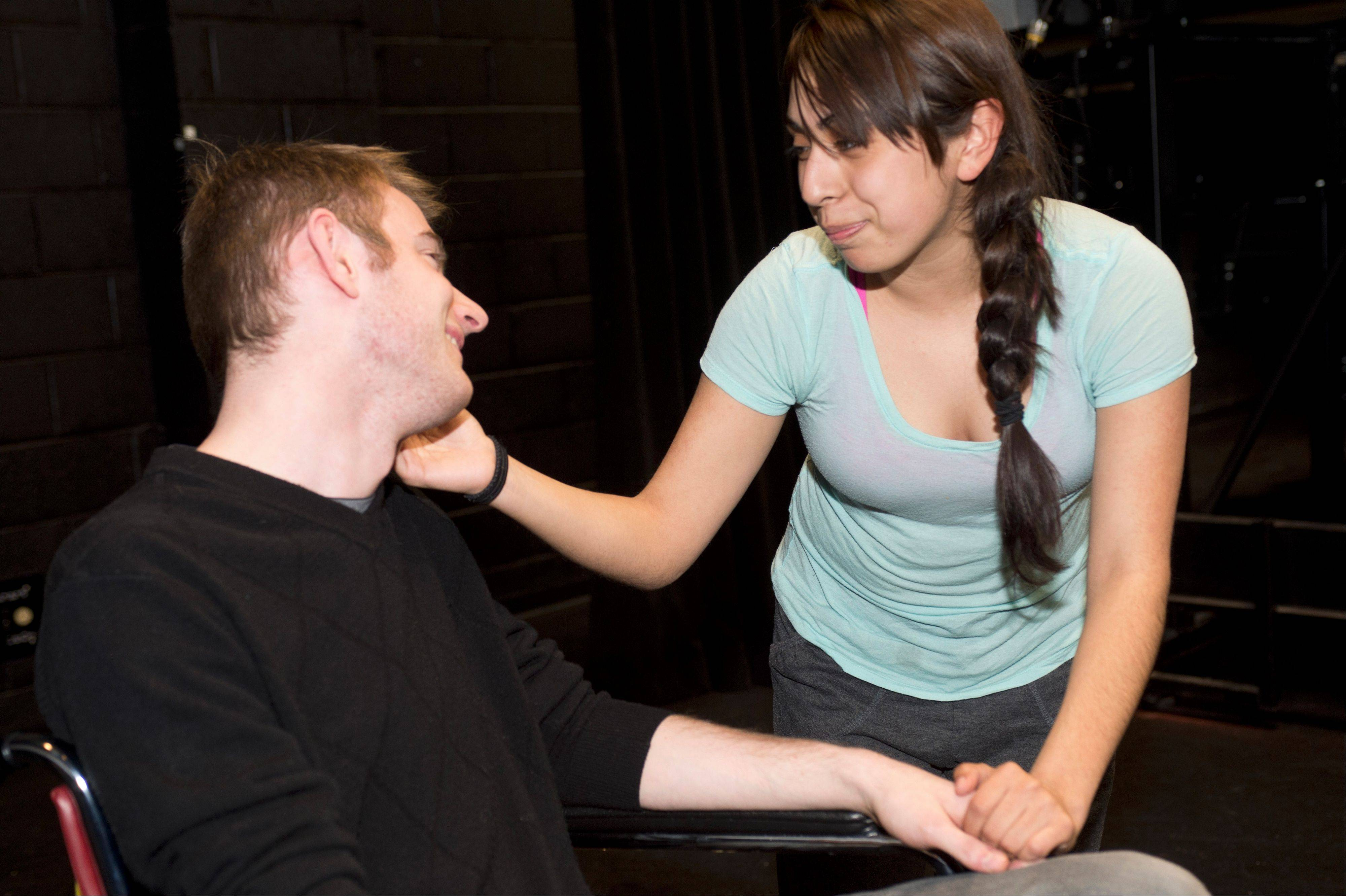 From left, Eric Wagner of St. Charles and Sonya Madrigal of Elgin rehearse their roles in �Our Lady of the Underpass,� which opens Friday, April 19, at Elgin Community College.
