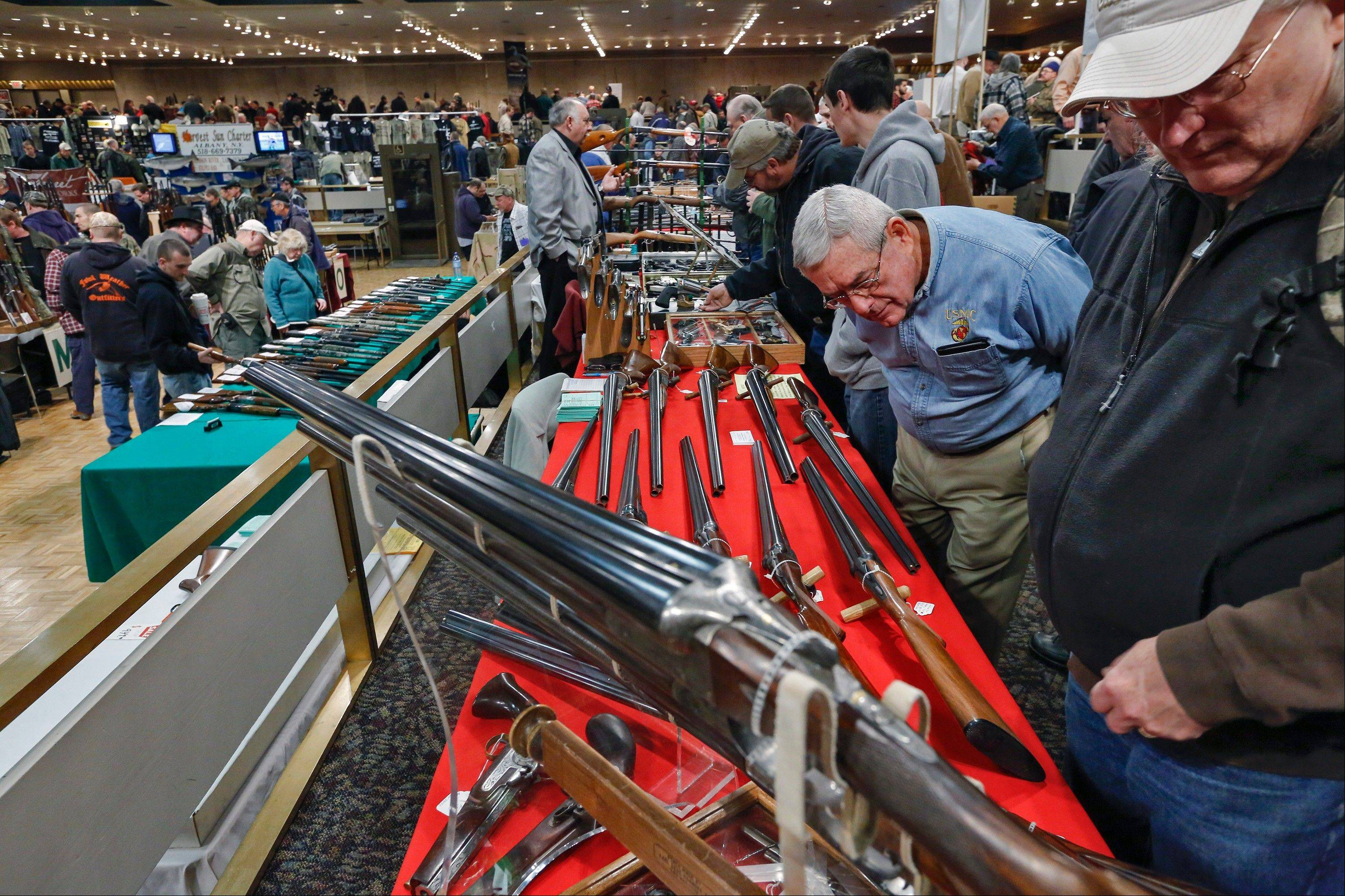 Key measures of New York�s tough new gun law are set to kick in, with owners of guns now reclassified as assault weapons required to register the firearms and new limits on the number of bullets allowed in magazines.