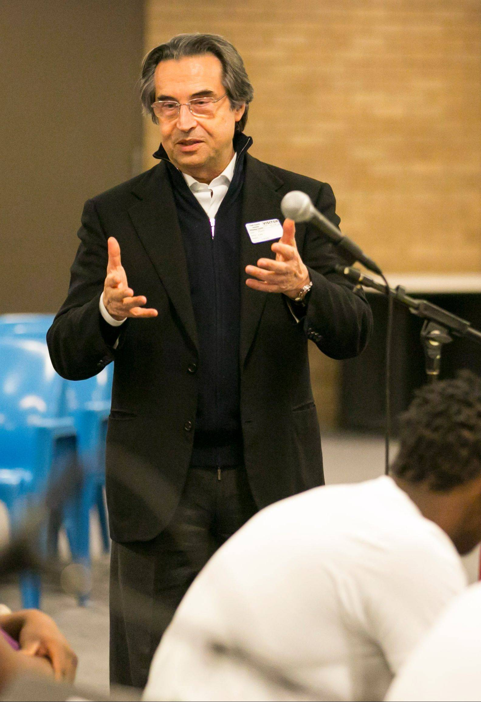 Chicago Symphony Orchestra Music Director Riccardo Muti talks to Cook County Juvenile Detention Center inmates following their music performance as part of the CSO's Citizen Musician program Sunday.