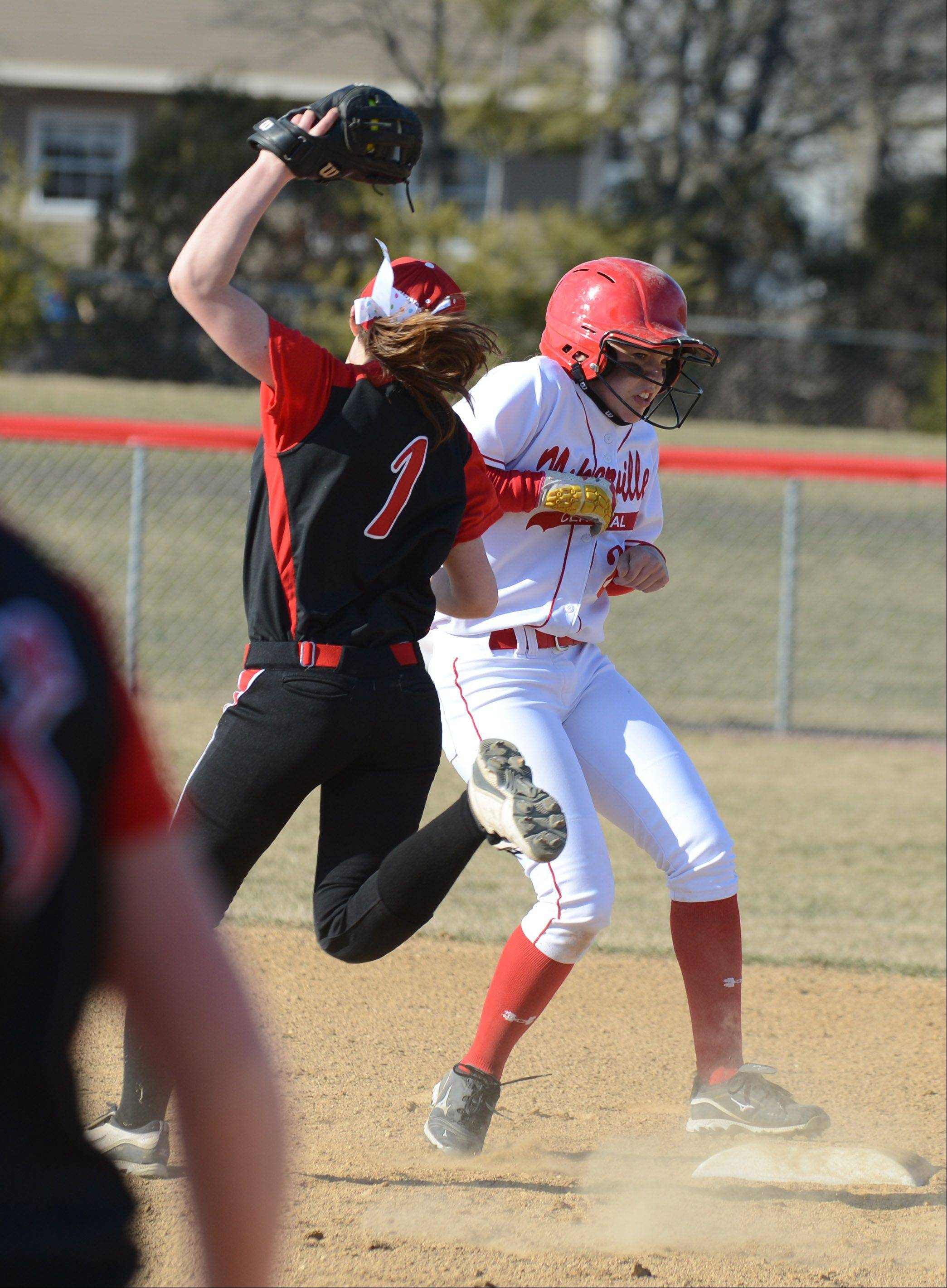 Ali Michalick of Benet trie to put the tag on Maddi Doane of Naperville Central during the Naperville Central at Benet softball game Thursday. This was at second. Shewas safe.