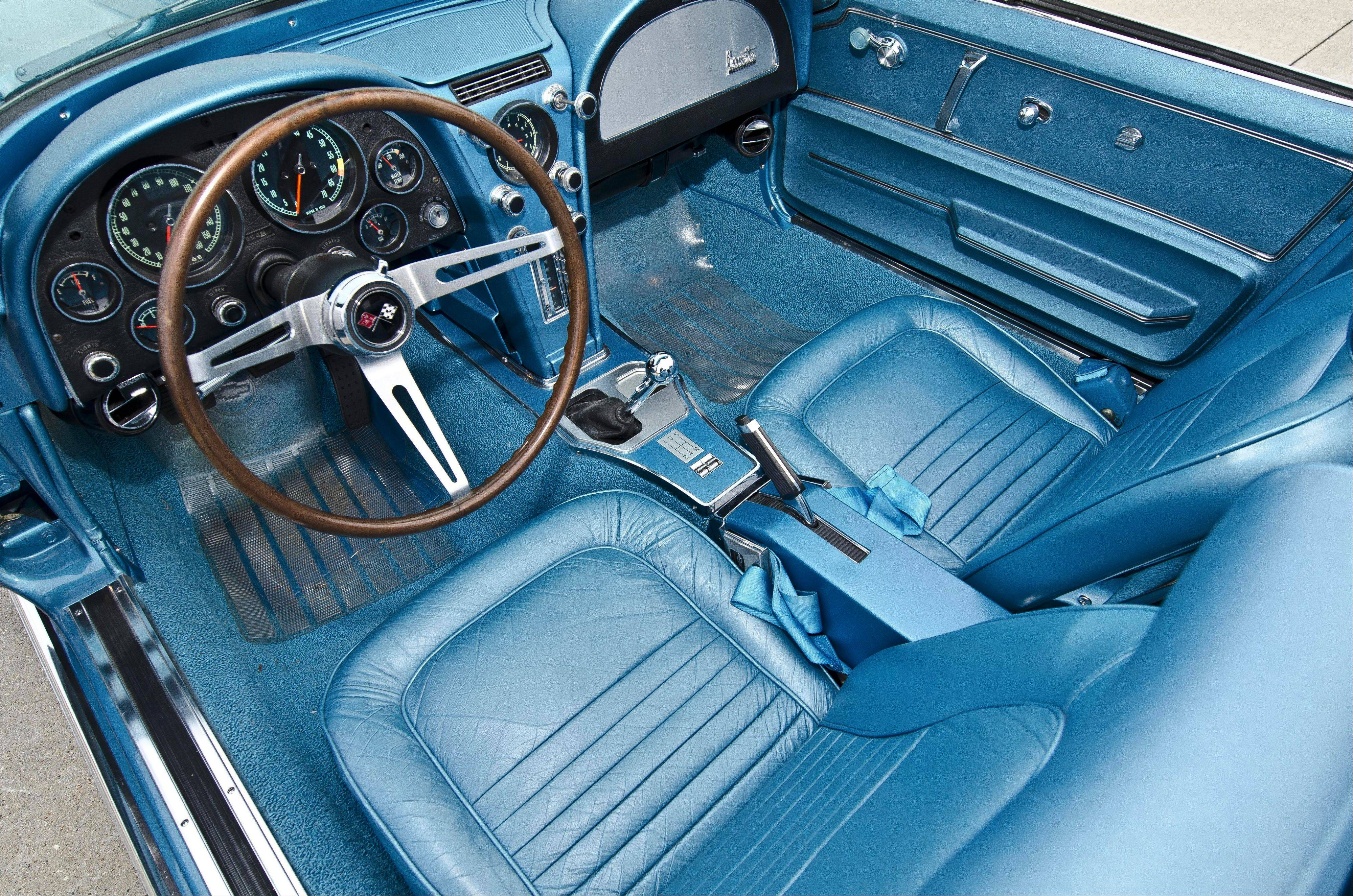 The interior matches the auto's Marina Blue paint.