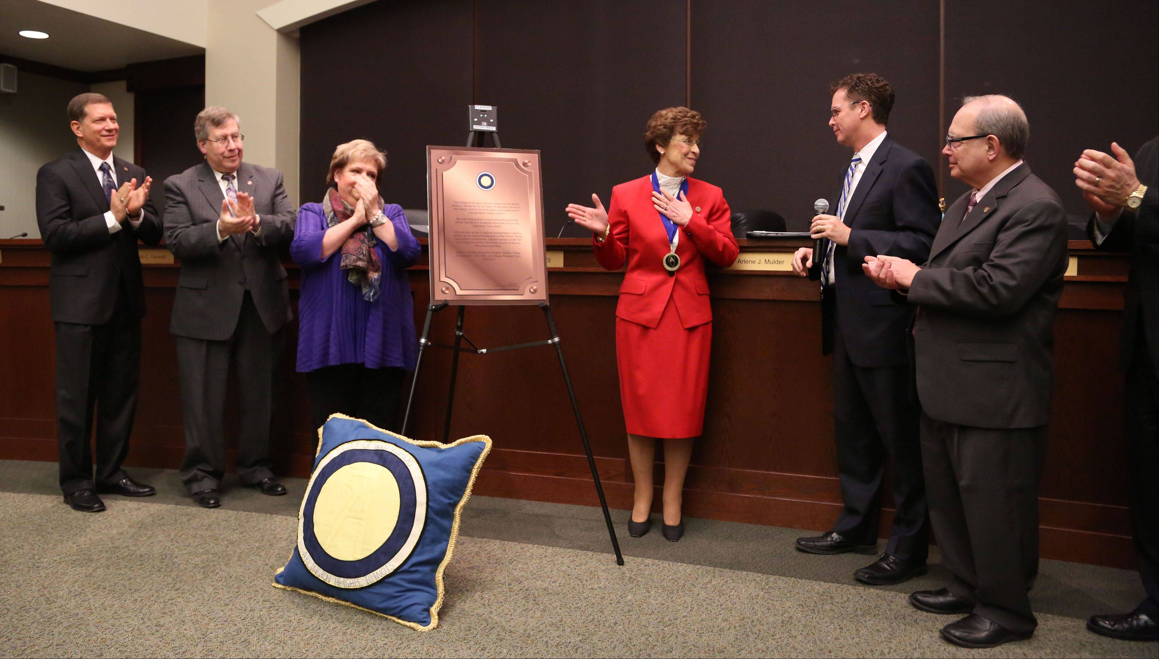 Arlene Mulder is presented with a plaque that will hang in the Metra station in honor of her 20 years of service as mayor of Arlington Heights.
