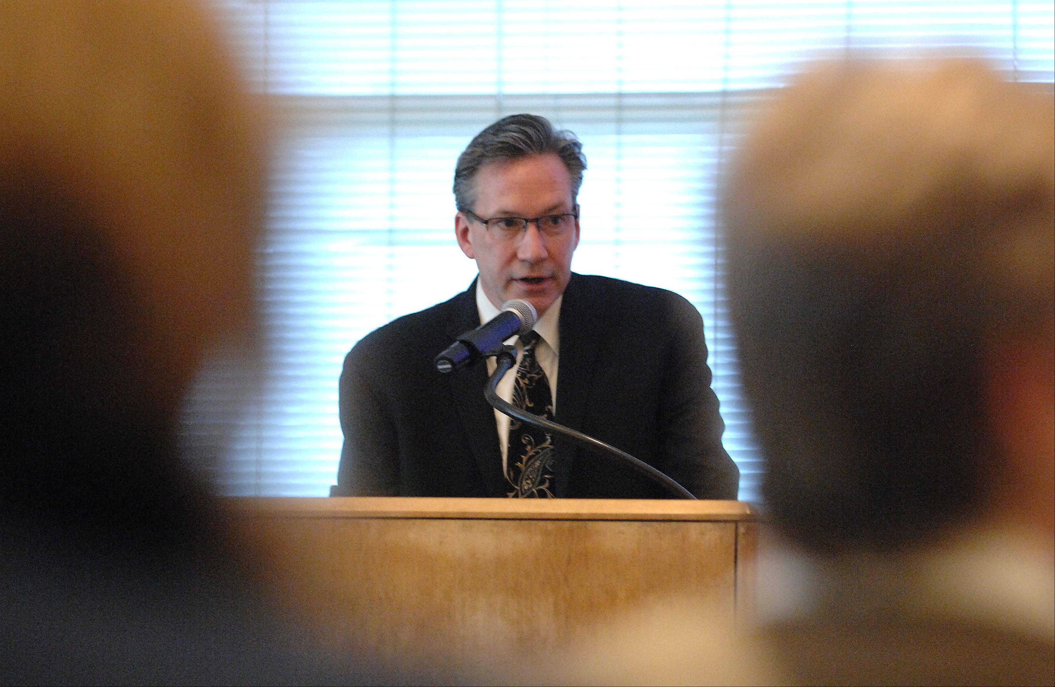 John Heinrich, director of diagnostics and oncology services for Centegra Health System in Crystal Lake, explains his opposition to a planned Sherman Hospital-Advocate Health Care merger during a hearing Monday conducted by the Illinois Health Facilities and Services Review Board Monday in Elgin.