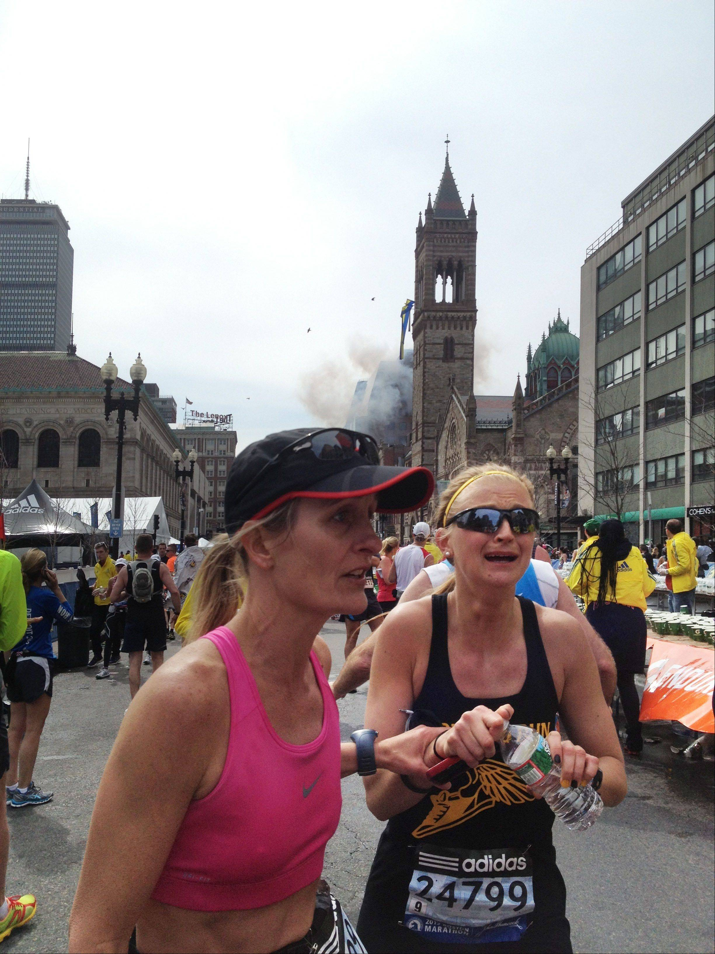 Two runners in the Boston Marathon react to the two explosions they heard Monday shortly after crossing the finish line.