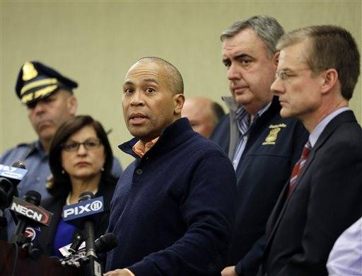 Massachusetts Gov. Deval Patrick speaks as Boston Police Commissioner Ed Davis, middle, and FBI Special Agent in Charge Richard DesLauriers, far right, listen at a news conference in Boston Monday, April 15, 2013 regarding two bombs which exploded in the street near the finish line of the Boston�Marathon on Monday, killing three people and injuring more than 130.