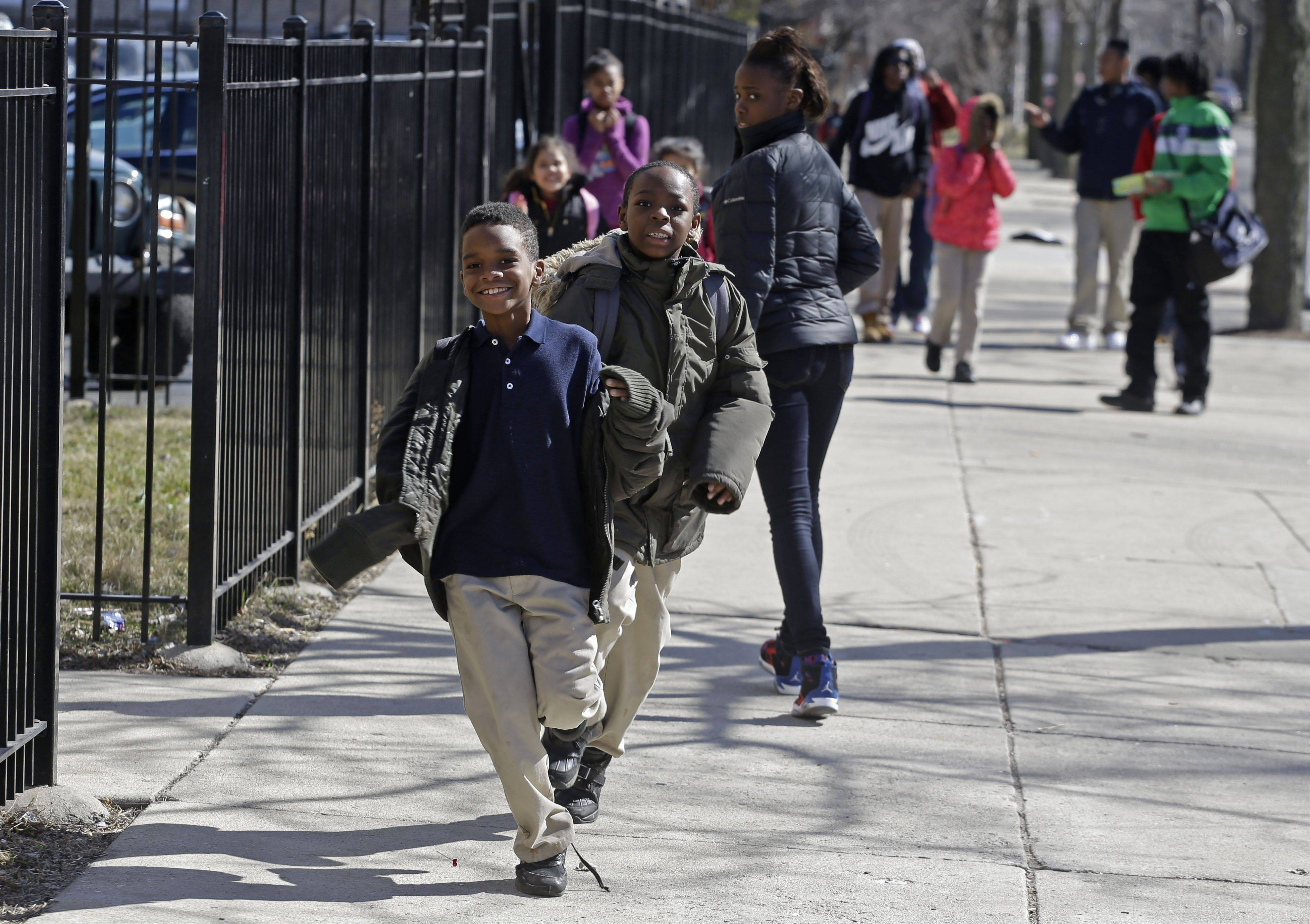 Children leave Dvorak Technology Academy in Chicago at the end of classes on April 3. While the school serves as a safe haven for children during classroom hours, their journeys to and from home are subject to peril as they cross gang borders that divide the city's neighborhoods.