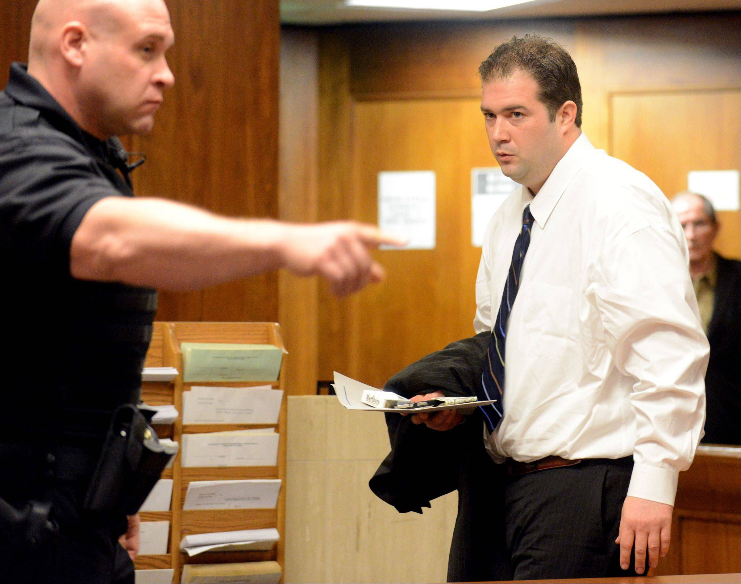 A Lake County sheriff's deputy shows Matthew Padour, 31, of Libertyville to a room in the Lake County courthouse after being sentenced by Judge Raymond Collins for attacking a Metra conductor in April 2012.