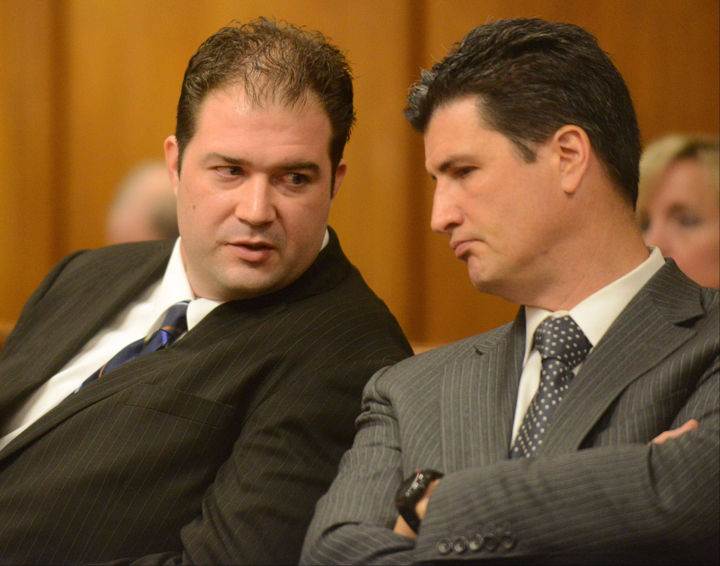 Matthew Padour, left, 31, of Libertyville speaks to his attorney, Frank Himel, during a sentencing hearing in front of Judge Raymond Collins at the Lake County Courthouse for attacking a Metra conductor in April 2012.