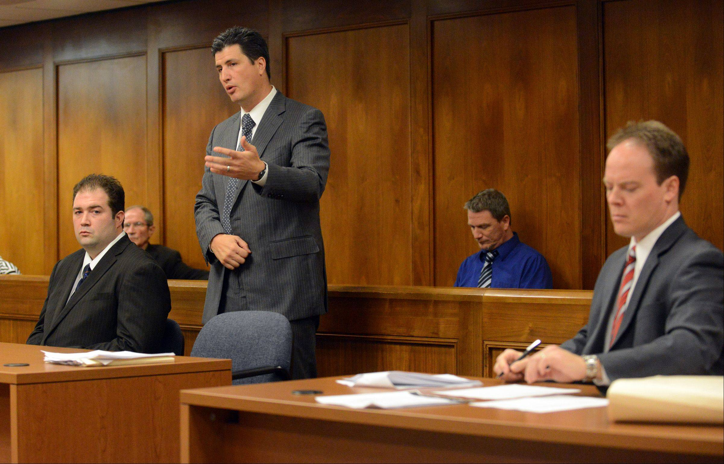 Matthew Padour, left, 31, of Libertyville listens to his attorney, Frank Himel, speak in his defense as assistant state's attorney Jim Newman takes notes during a sentencing hearing at the Lake County Courthouse for attacking a Metra conductor in April 2012.