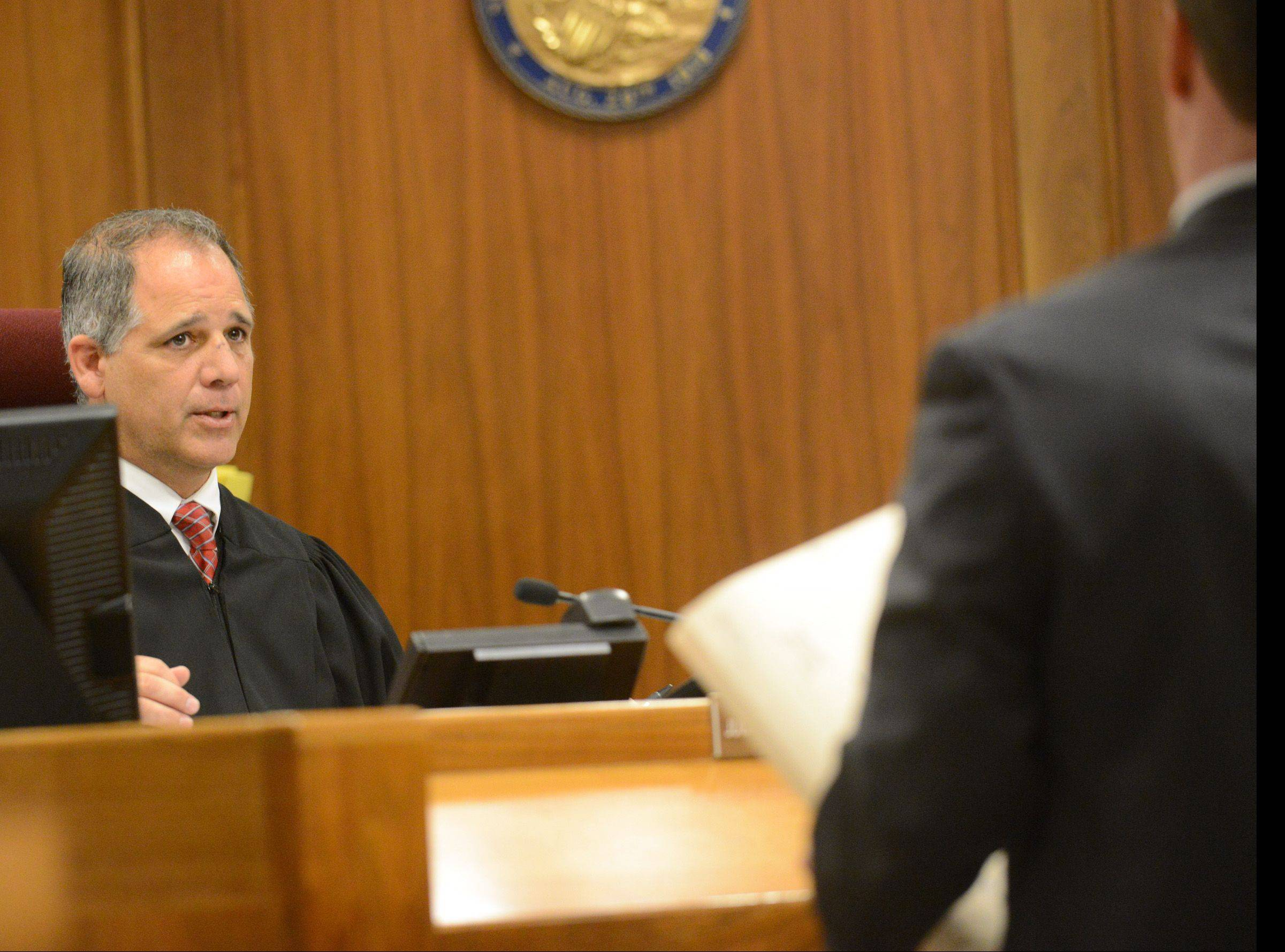 Judge Raymond Collins talks to attorneys during the sentencing hearing of Matthew Padour, 31, of Libertyville who was convicted of attacking a Metra conductor in April 2012. It marked the first time cameras were allowed in a Lake County courtroom.