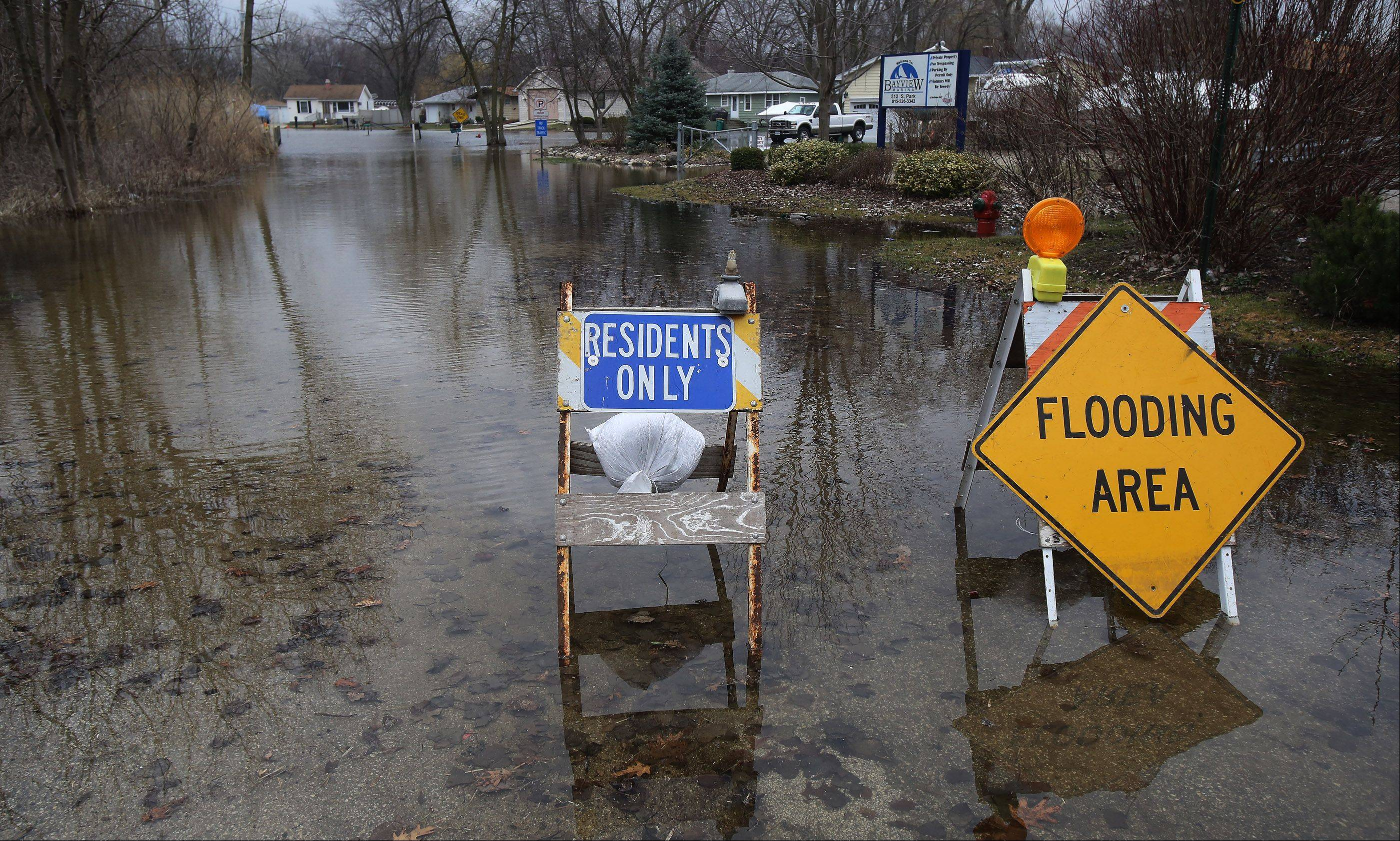 High waters block the entrance into Bayview Marina in Fox Lake Monday. Area residents are watching the weather forecasts for signs that flooding could worsen in Lake County.