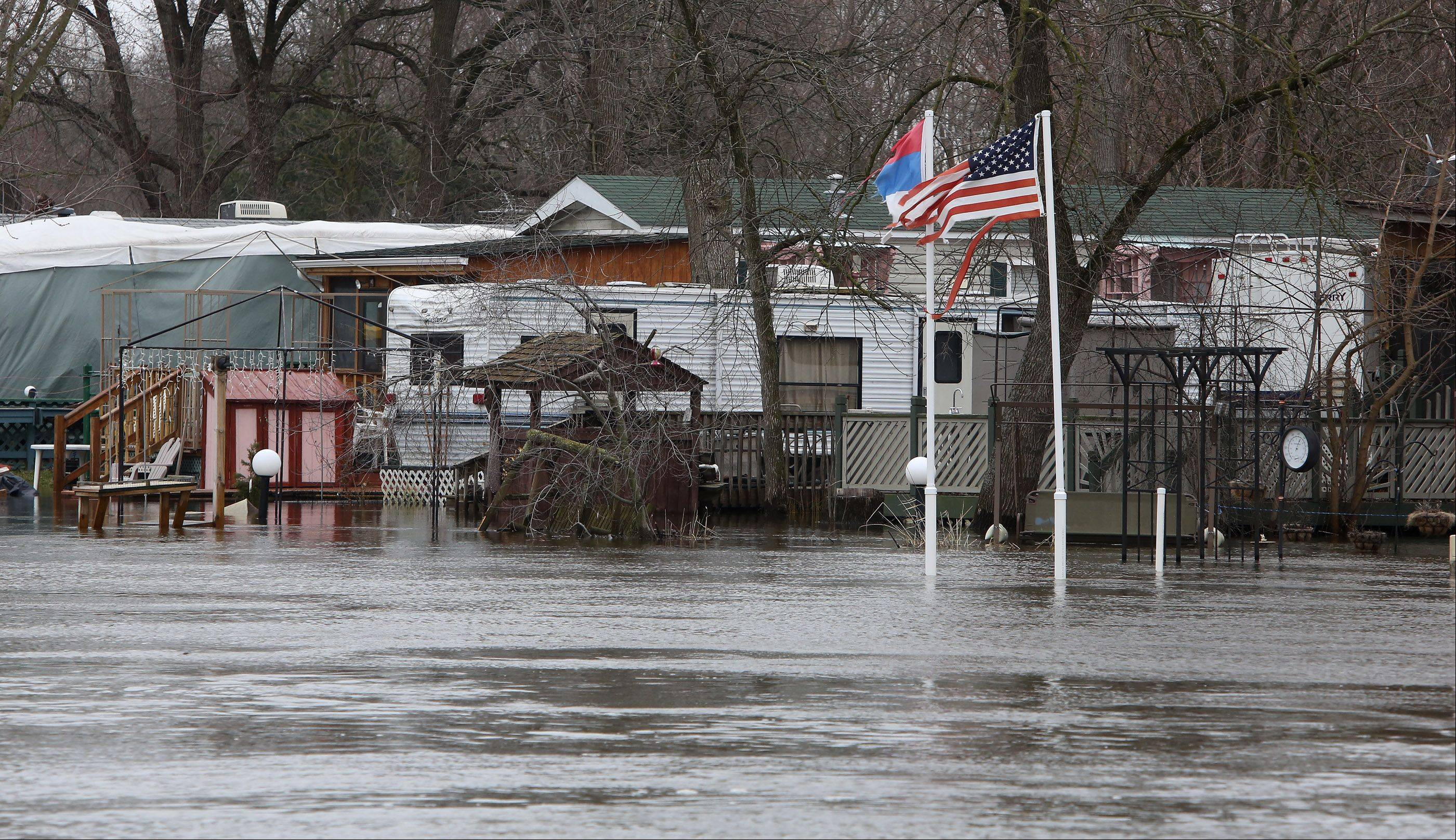 Water along the Fox River in Lake County creeps toward homes near Fox River Springs neighborhood in Antioch on Monday.
