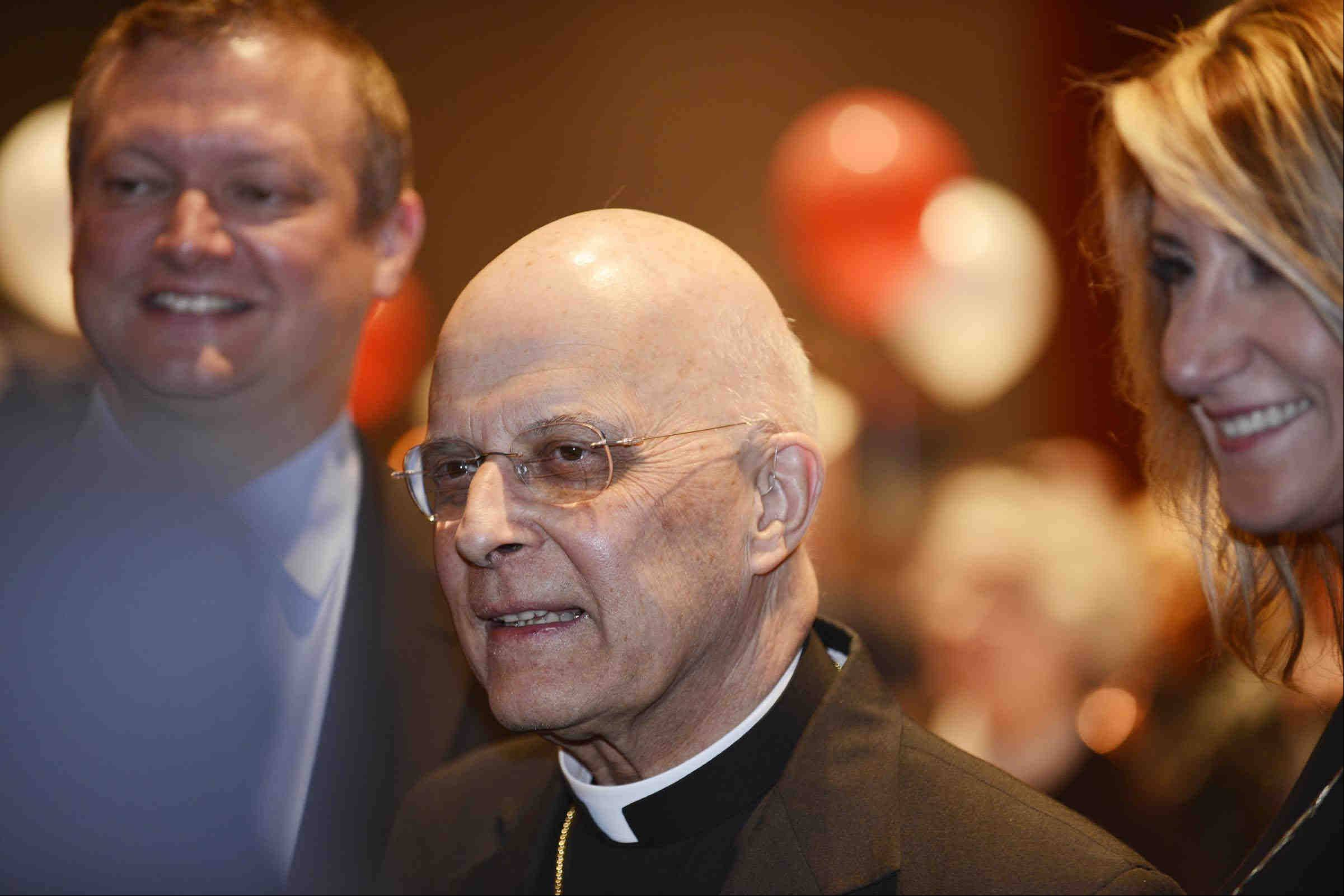 John Starks/jstarks@dailyherald.comFrancis Cardinal George walks through a crowd of almost 400 people Sunday evening before the Amazing Grace Gala at The Stonegate Banquet Centre in Hoffman Estates.