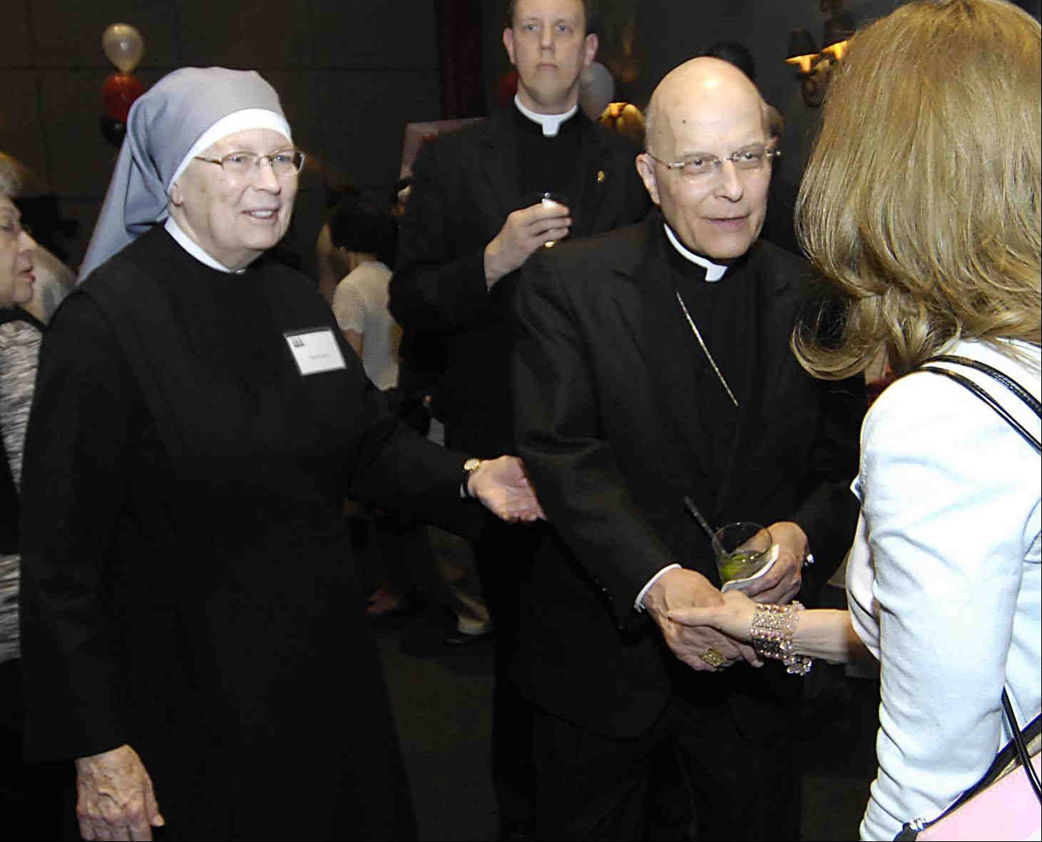 Francis Cardinal George greets people Sunday evening at the Amazing Grace Gala Dinner with Mother Marguerite McCarthy, President of Little Sisters of the Poor at St. Joseph's Home for the Elderly.
