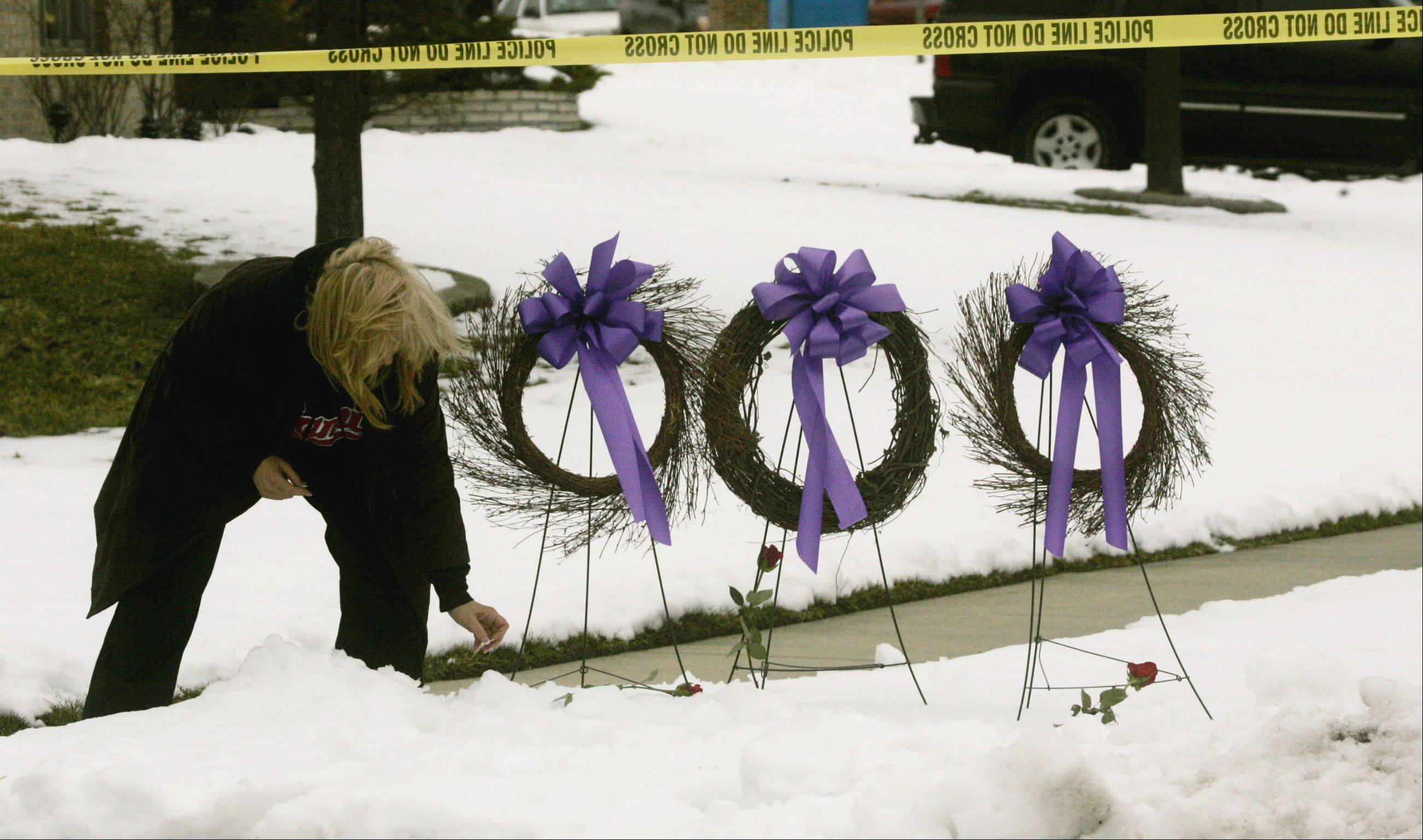 herald file photoA neighbor set up a memorial for the victims of a triple homicide in a Darien home.