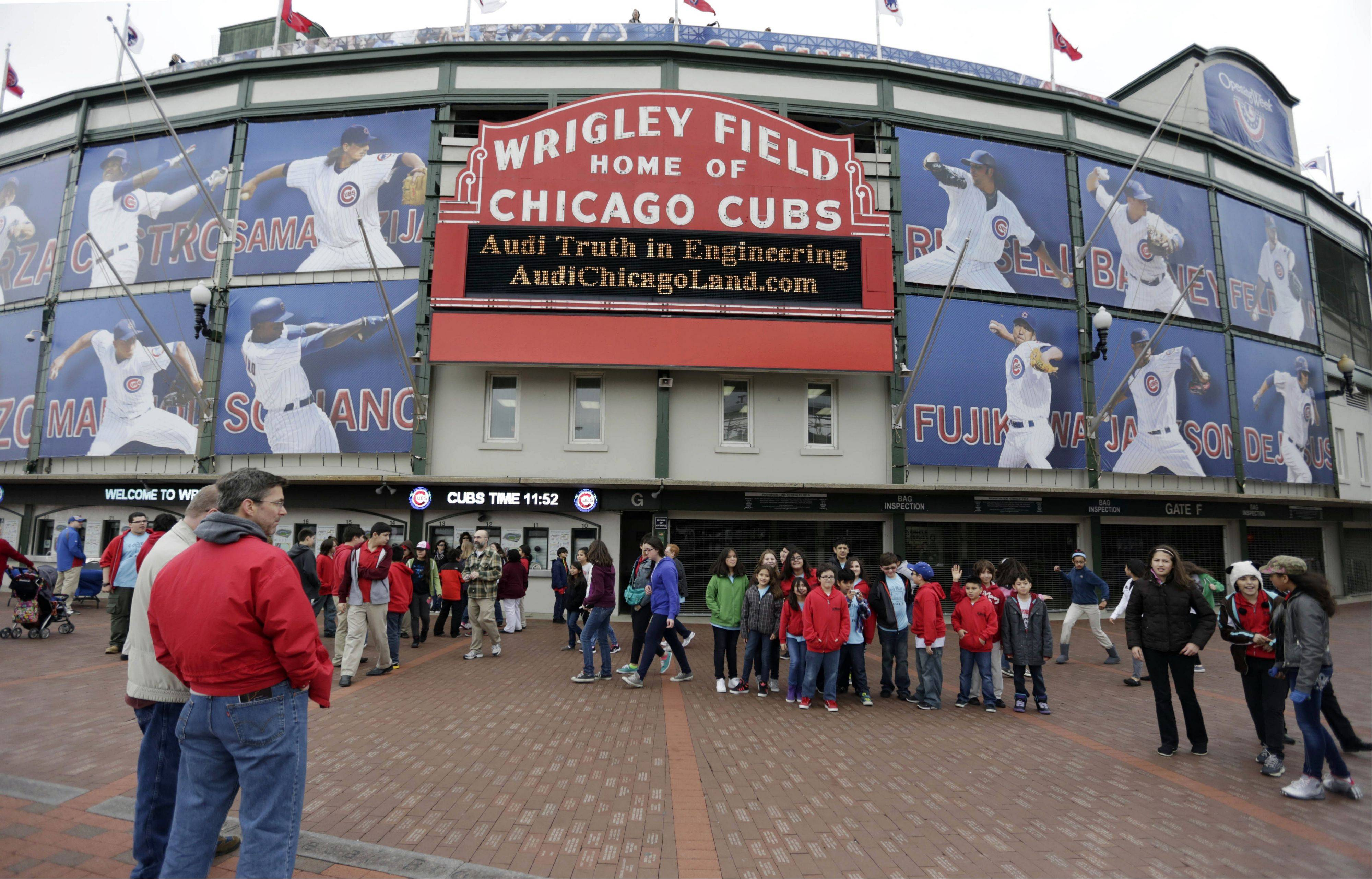 This photo taken Monday, April 15, 2013, in Chicago shows the exterior of Wrigley Field, home of the Chicago Cubs baseball club. During a news conference today, Chicago Cubs chairman Tom Rickets said the Cubs and the city have agreed on details of a $500 million facelift for Wrigley Field, including an electronic video screen that is nearly three times as large as the one currently atop the center-field bleachers of the 99-year-old ballpark.